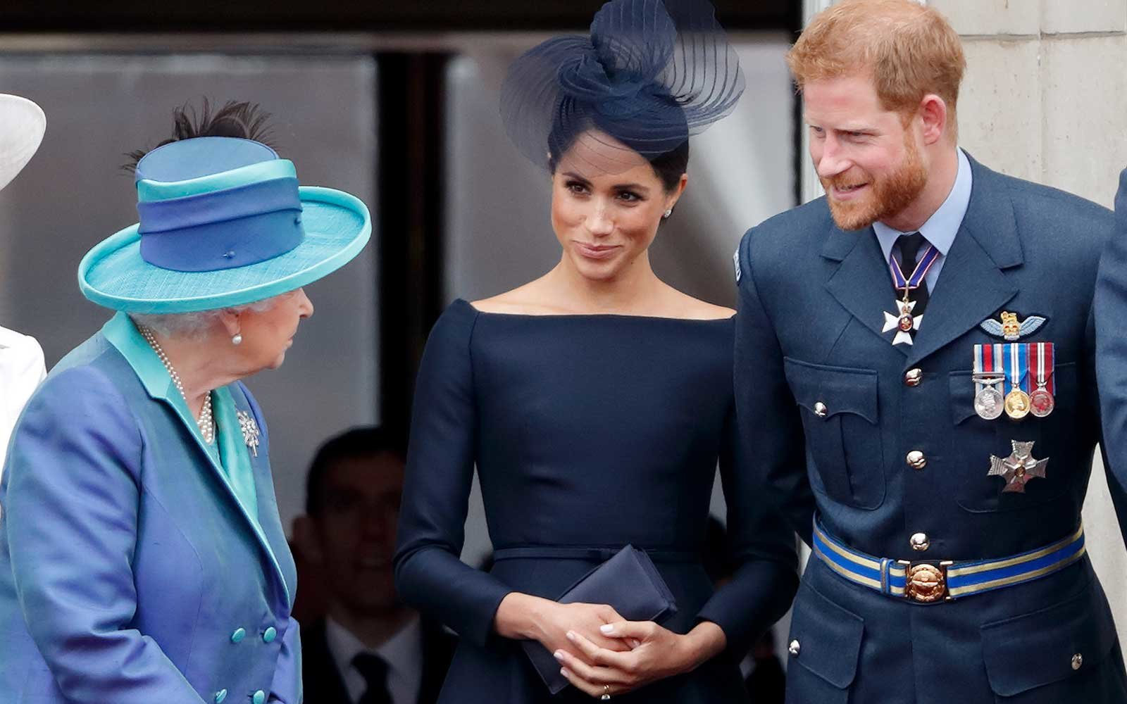Queen Elizabeth II, Meghan, Duchess of Sussex and Prince Harry, Duke of Sussex
