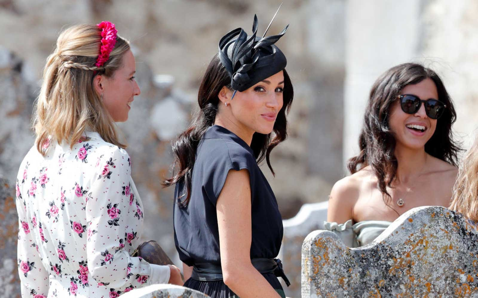 Meghan, Duchess of Sussex attends the wedding of Charlie van Straubenzee and Daisy Jenks at the church of St Mary the Virgin