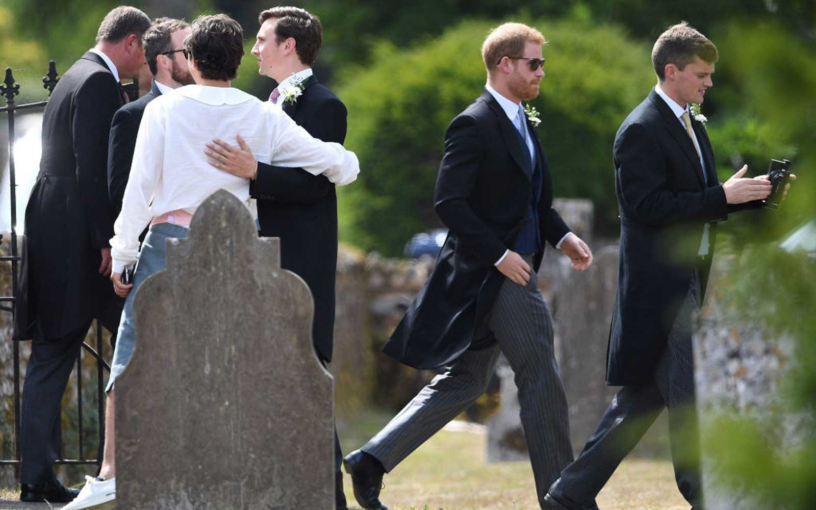 The Duke of Sussex (2nd right) arrives to attend the wedding of Charlie van Straubenzee (4th left) and Daisy Jenks at St Mary the Virgin Church in Frensham, Surrey.