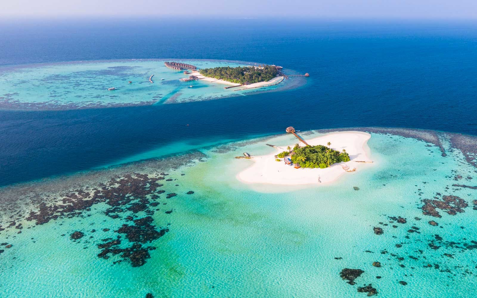 Aerial drone view of a tropical island in the Maldives