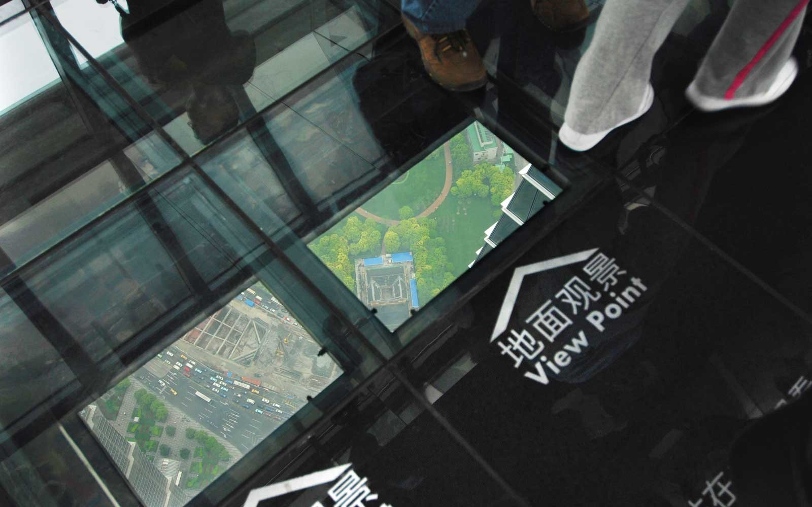 Glass sections in the floor of the observation deck on the 101st floor of the Shanghai World Financial Center