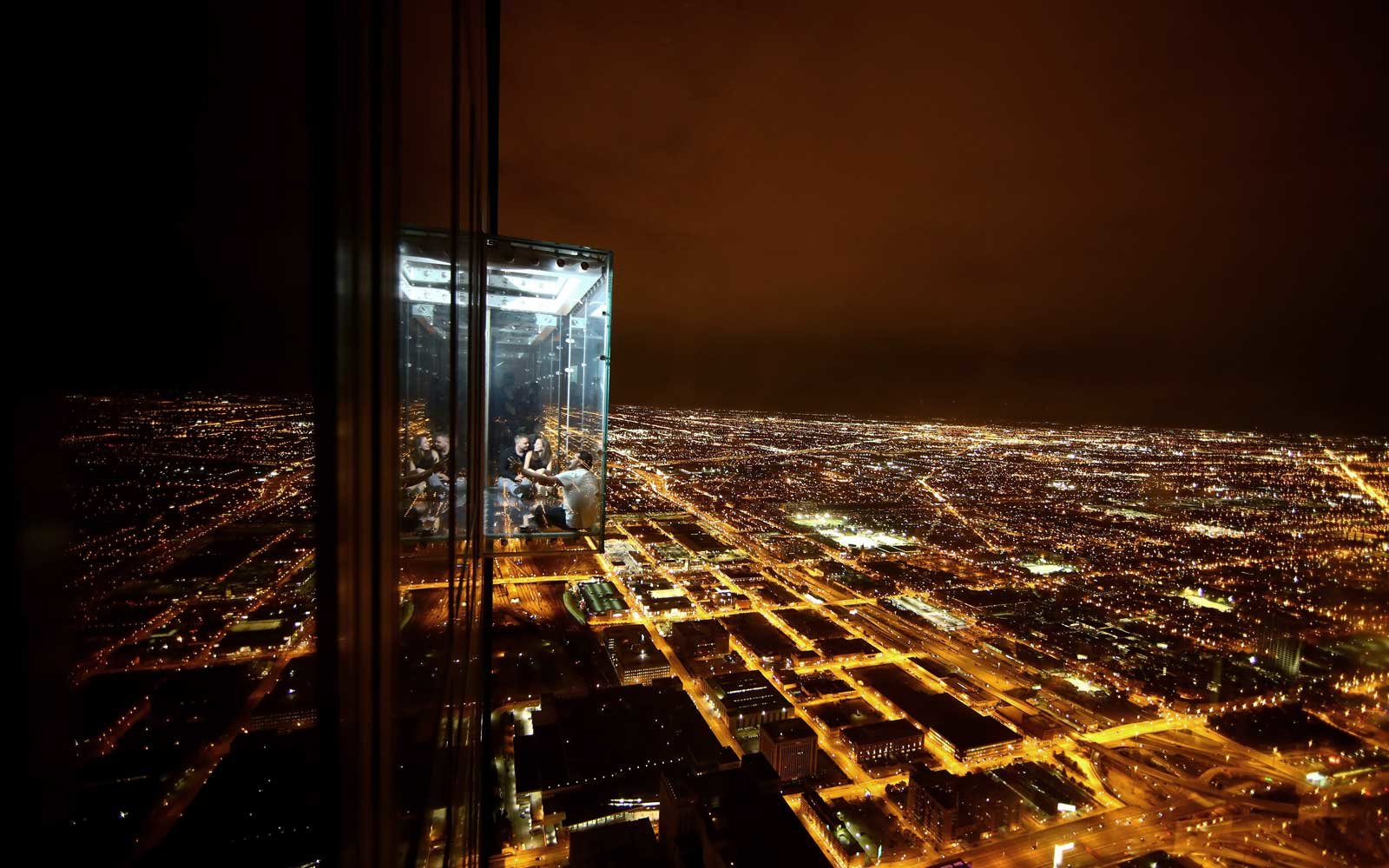 eople are seen at Skydeck Ledge, which is located on the 103rd floor of Willis Tower, second-tallest in United States, in Chicago