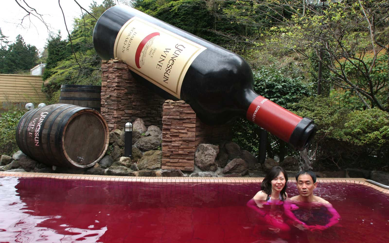 A couple bathe in the red wine bath, ( a bath containing real red wine), at Hakone Kowakien Yunessun in Tokyo, Japan
