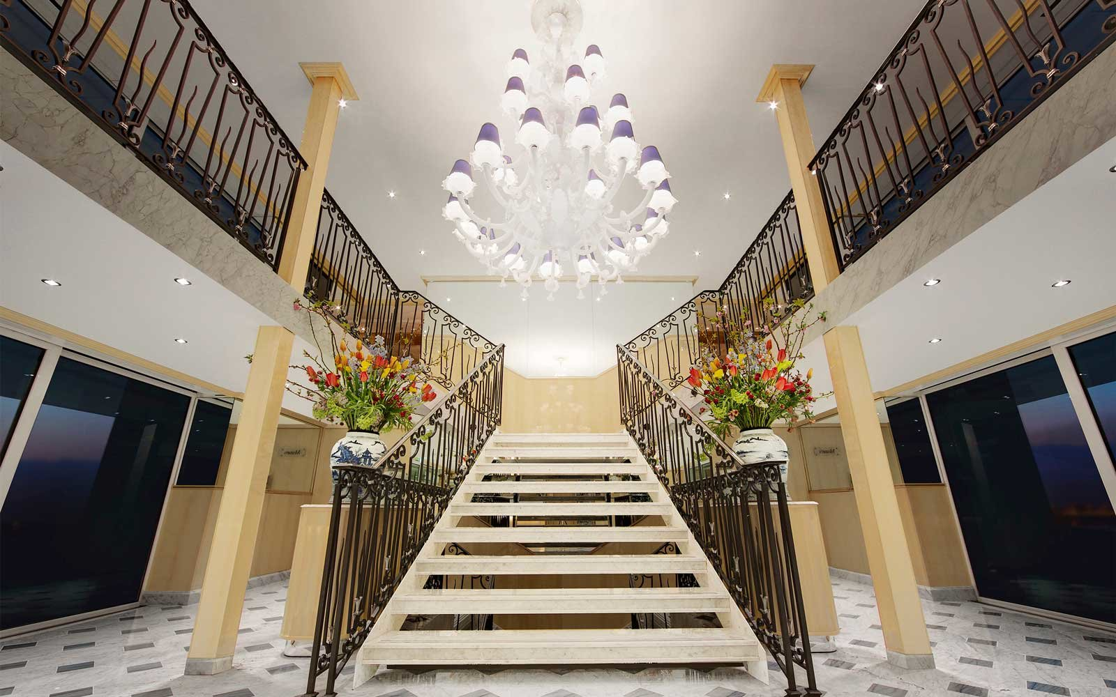 Staircase and Murano glass chandelier on board the Uniworld S.S. Beatrice