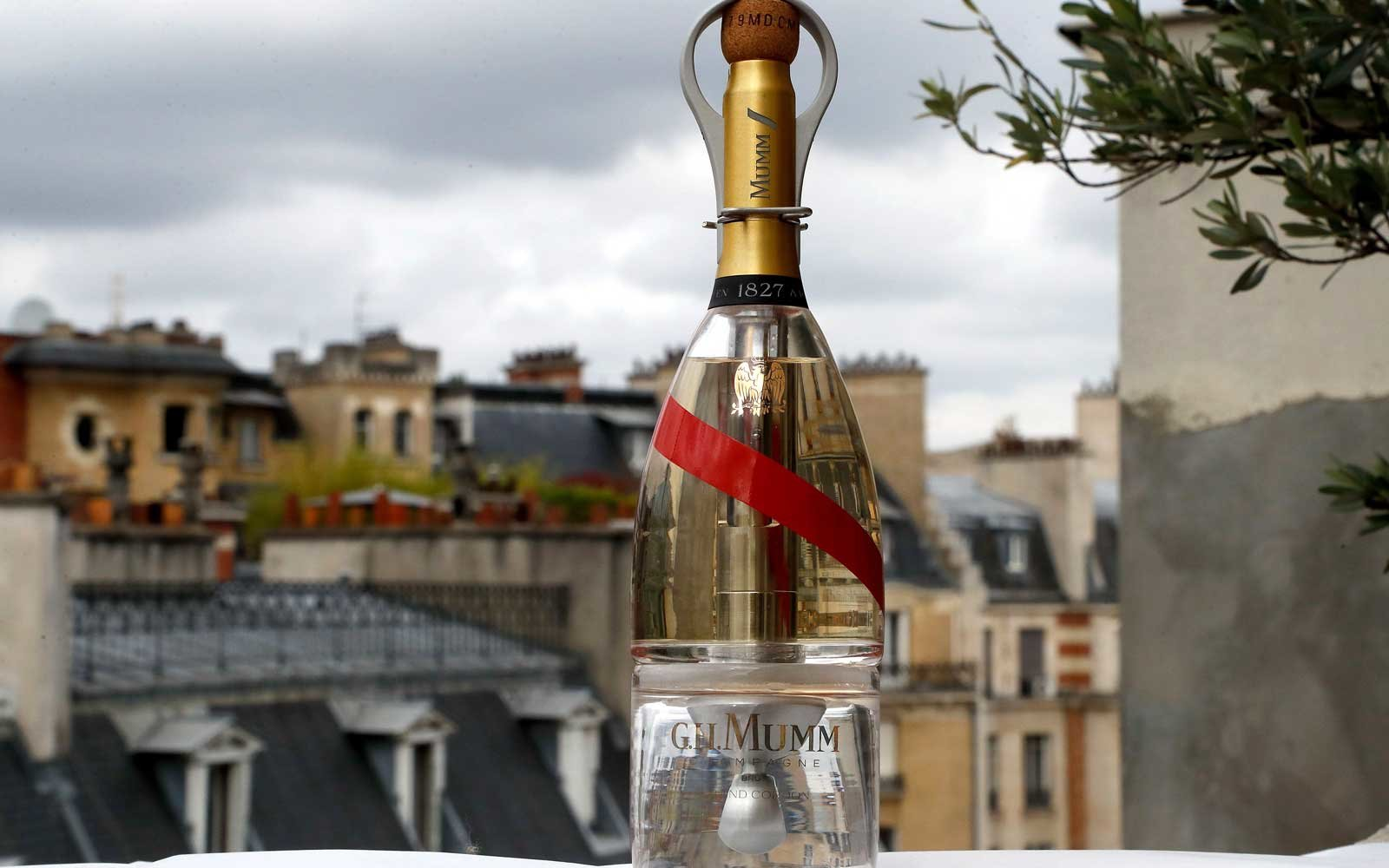 A picture taken on September 6, 2018 in Paris shows a bottle of Mumm Grand Cordon Stellar champagne, designed by French Interior designer Octave de Gaulle, that will be drank by space tourists using a container bottle adapted to pour the bubbly liquid in