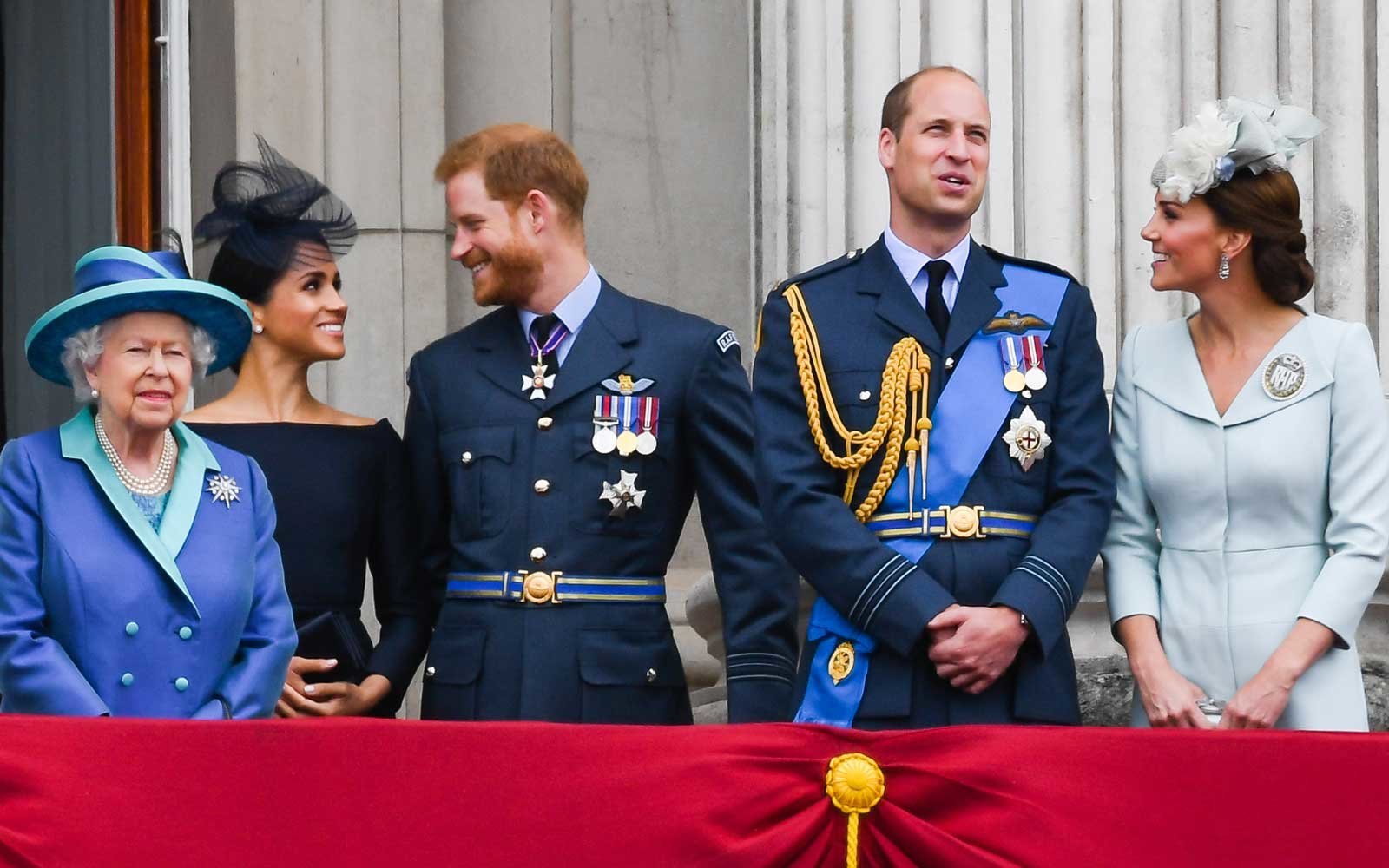 Queen Elizabeth ll, Meghan, Duchess of Sussex, Prince Harry, Duke of Sussex, Prince William, Duke of Cambridge and Catherine, Duchess of Cambridge stand on the balcony of Buckingham Palace to view a flypast to mark the centenary of the Royal Air Force (RA