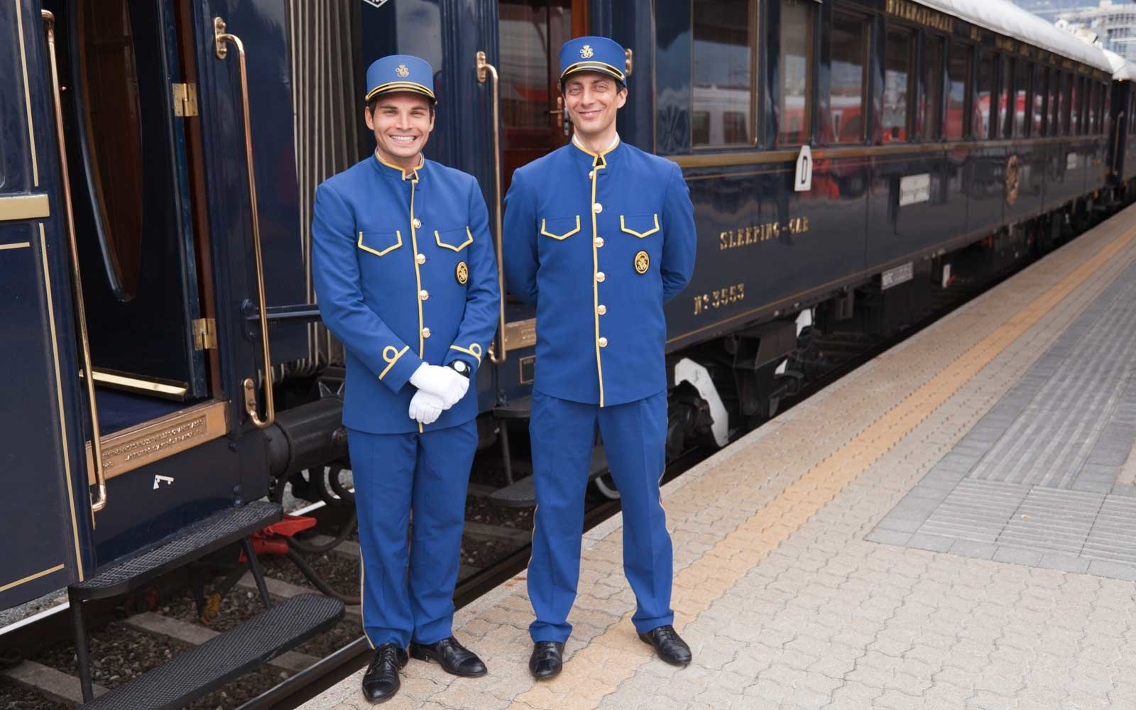 Stewards on the Venice Simplon Orient Express train, having a short stop at Innsbruck, Austria