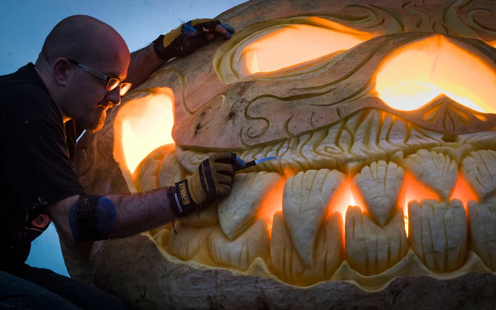 Pumpkin carver Christian Russell puts the finishing touches to a 'World Record Breaking' Jack O