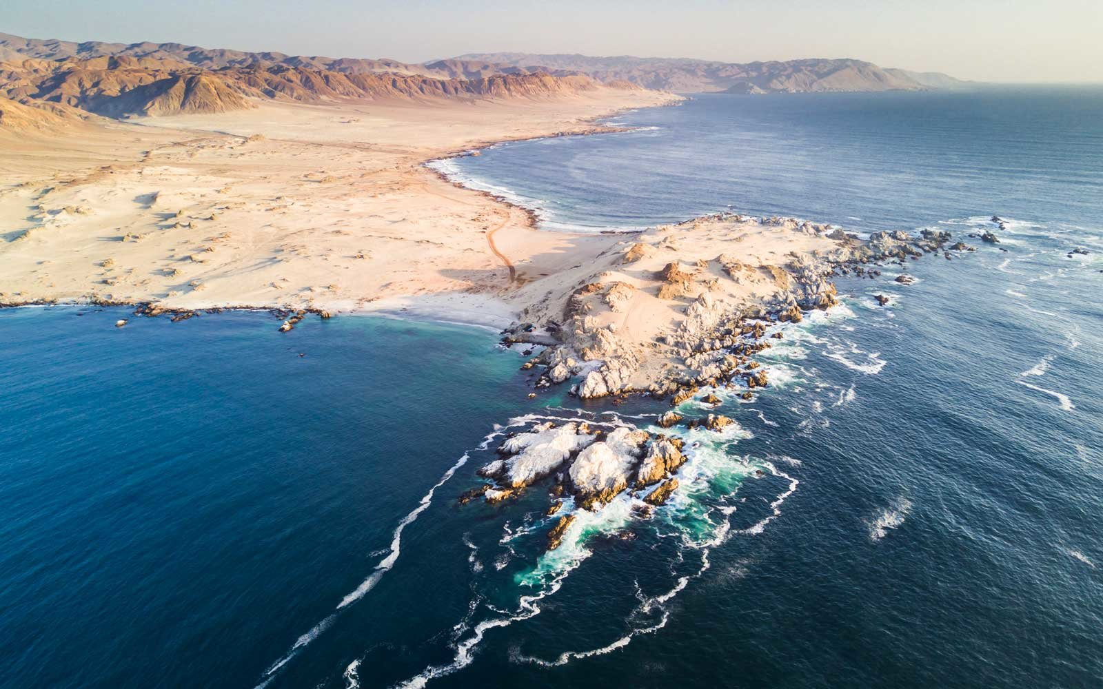 Atacama Desert has amazing beaches like this one called  Las Tortolas  in Taltal town at Antofagasta region, Chile.