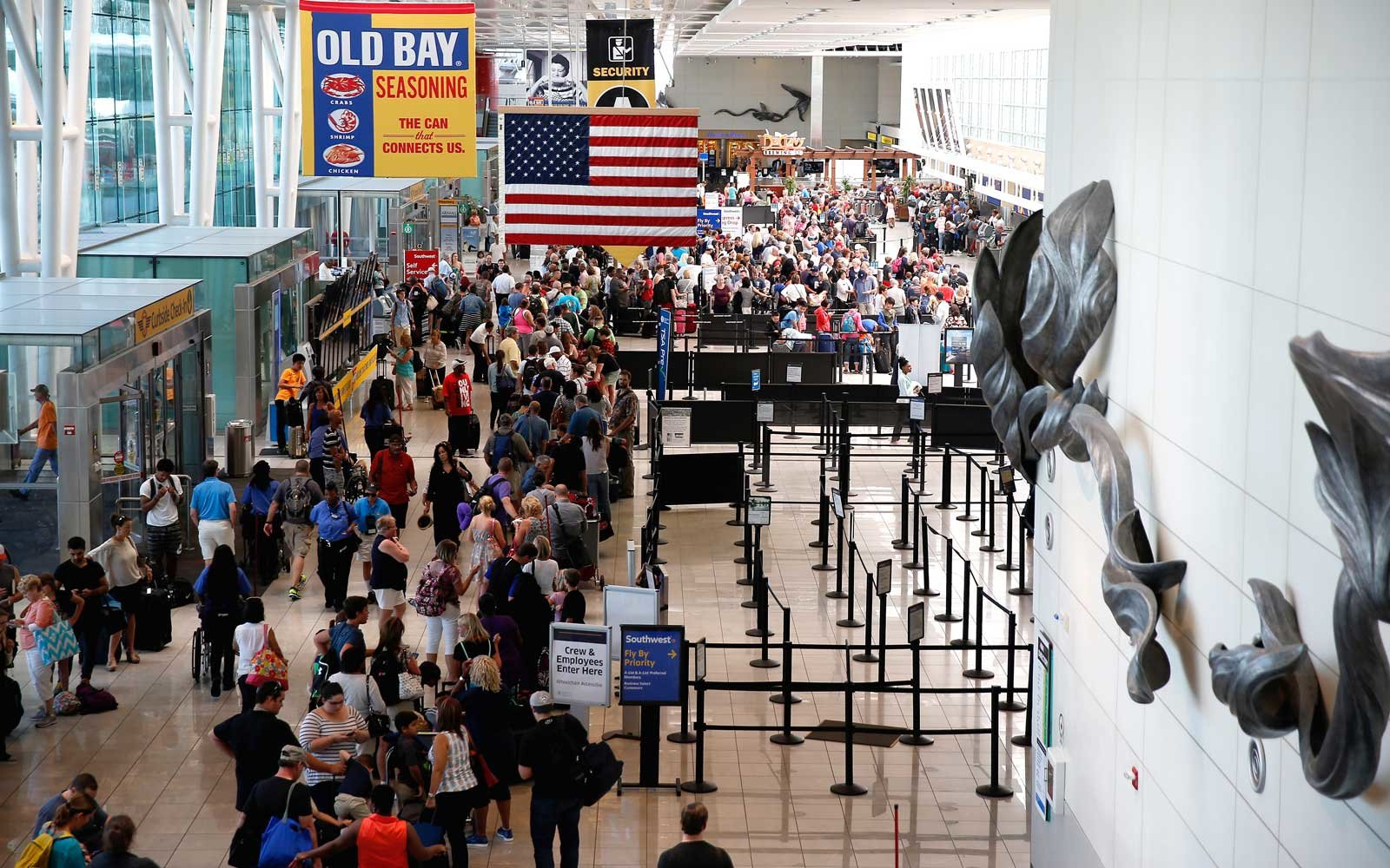 Travelers wait in line at the Southwest ticket check in at Baltimore/Washington International Thurgood Marshall Airport