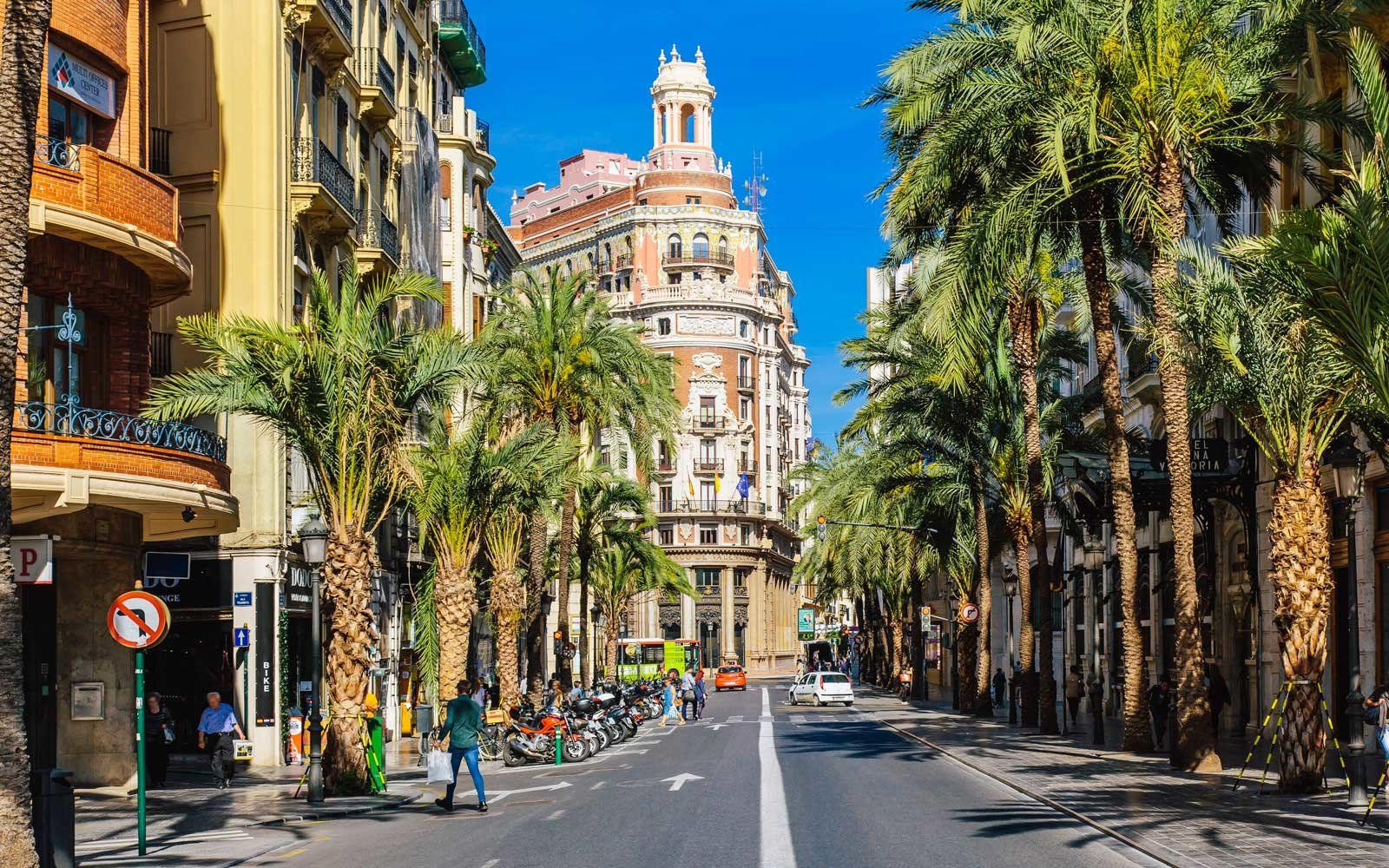 Carrer de les Barques street with palm trees on a sunny day in Valencia, Spain