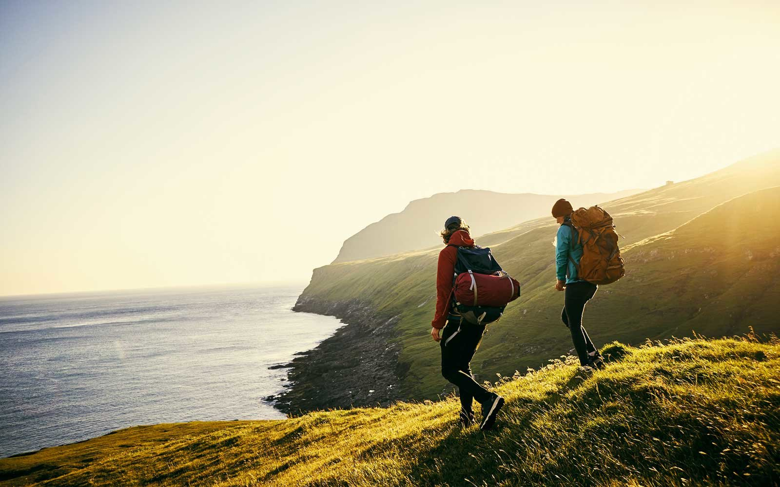 Young couple hiking in the Faroe Islands
