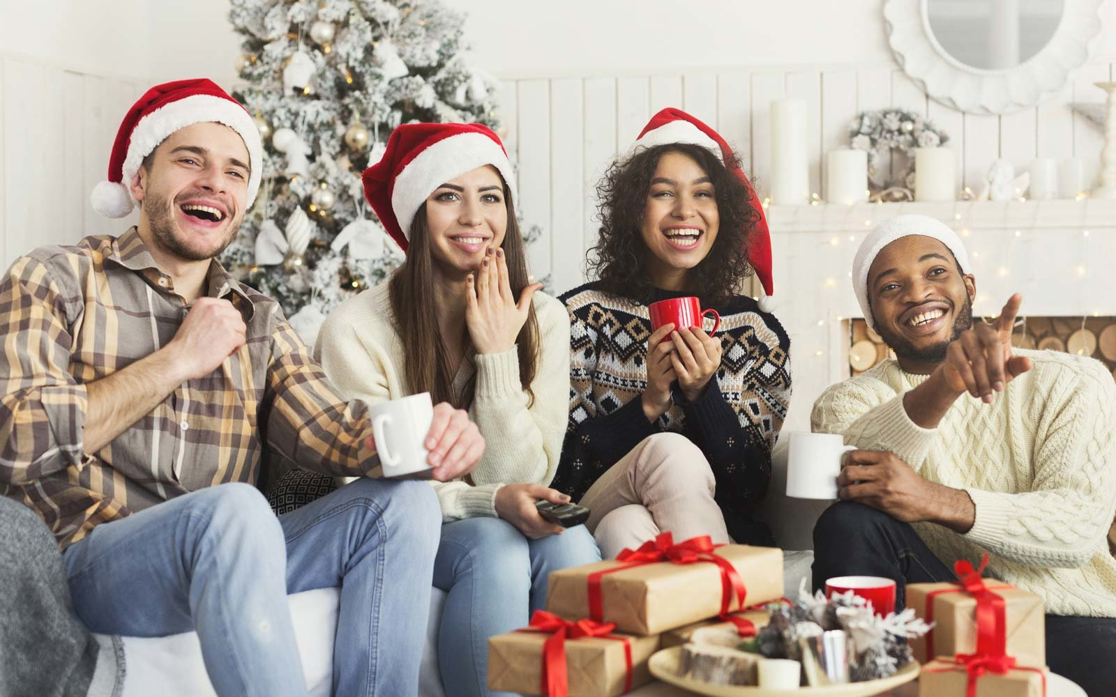 Friends watching movie and having fun at Christmas eve.