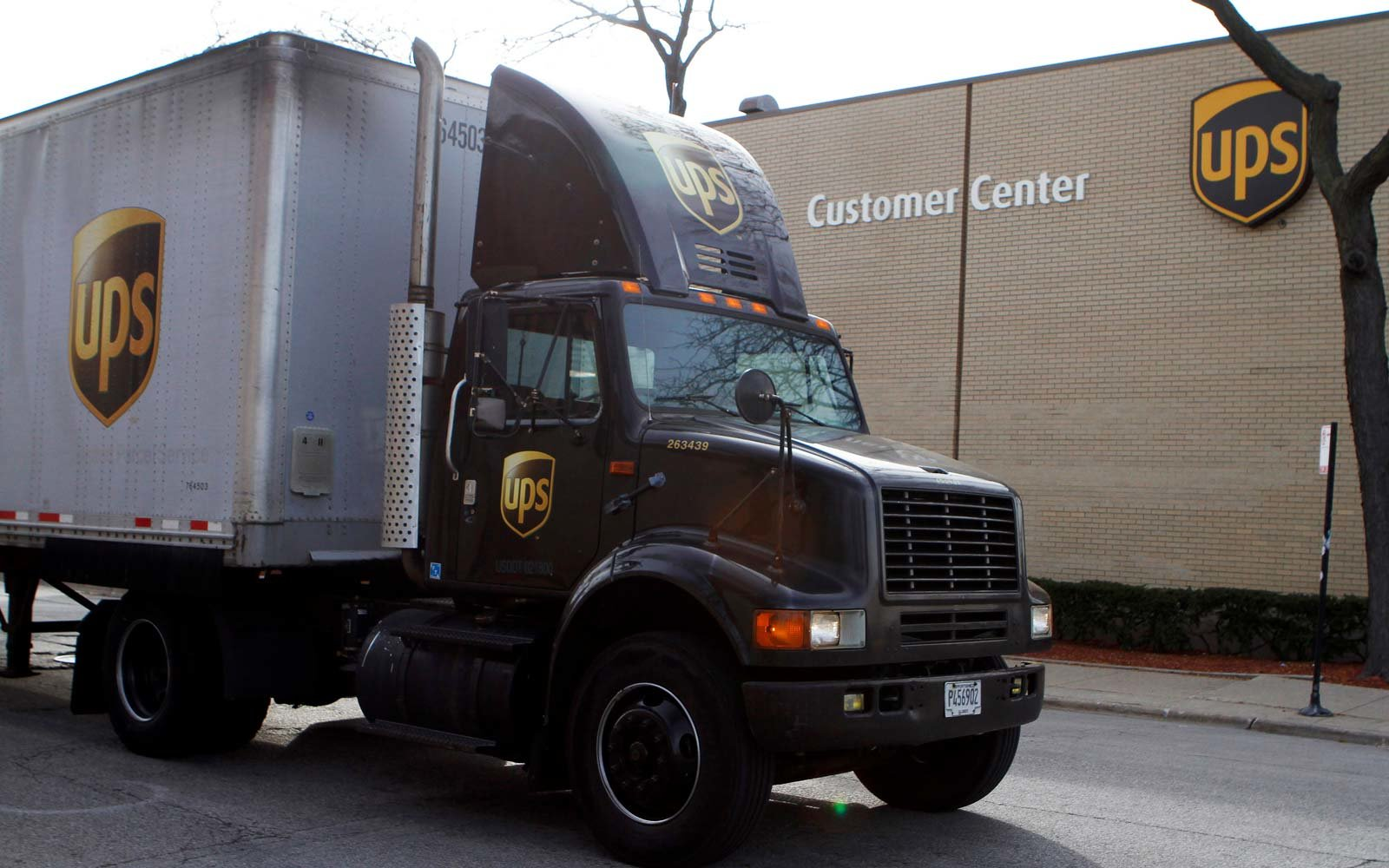 A United Parcel Service (UPS) truck leaves the yard