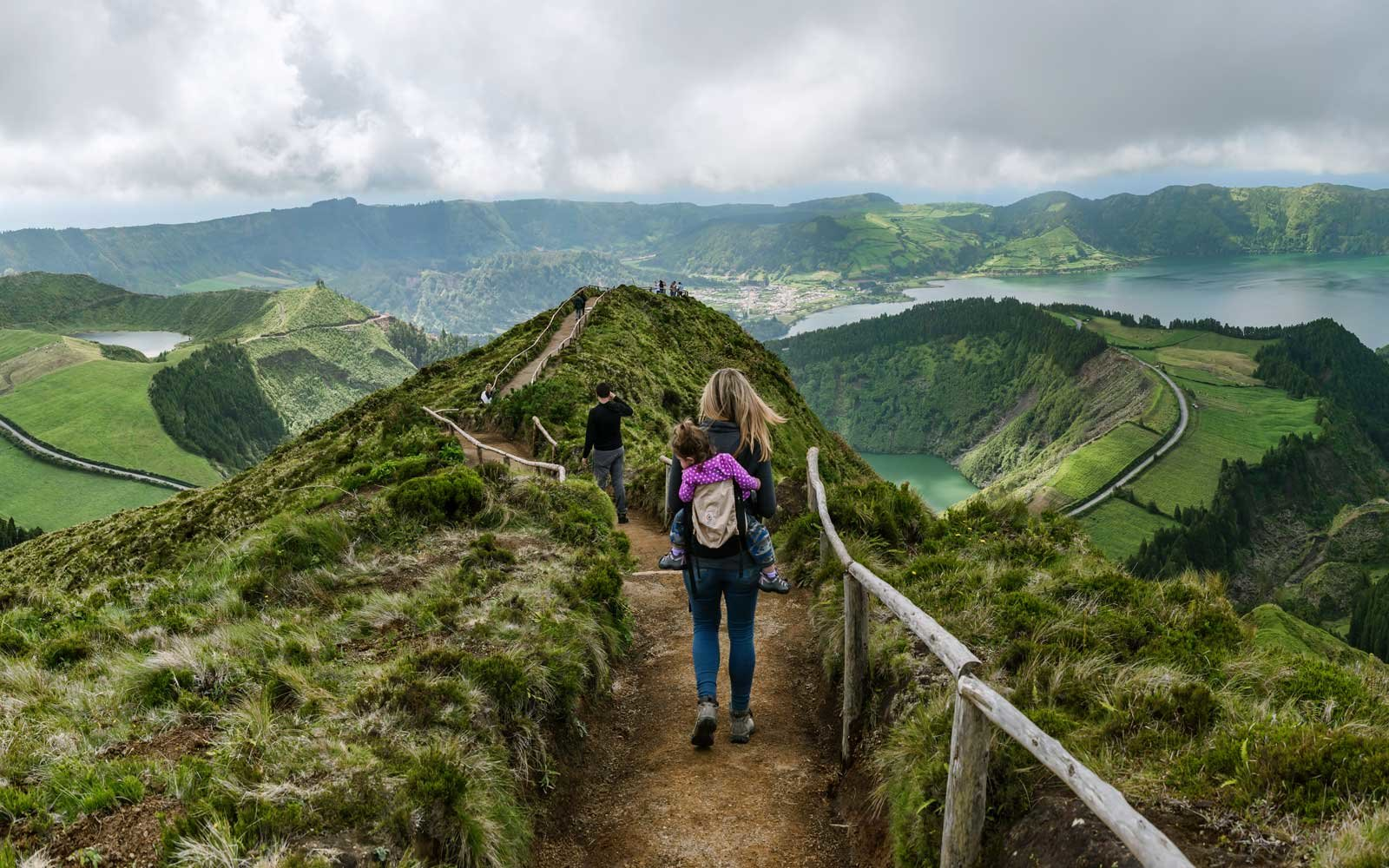 Rear view of female hiker on Sete Cidades Caldara, Sao Miguel Island, Azores, Portugal