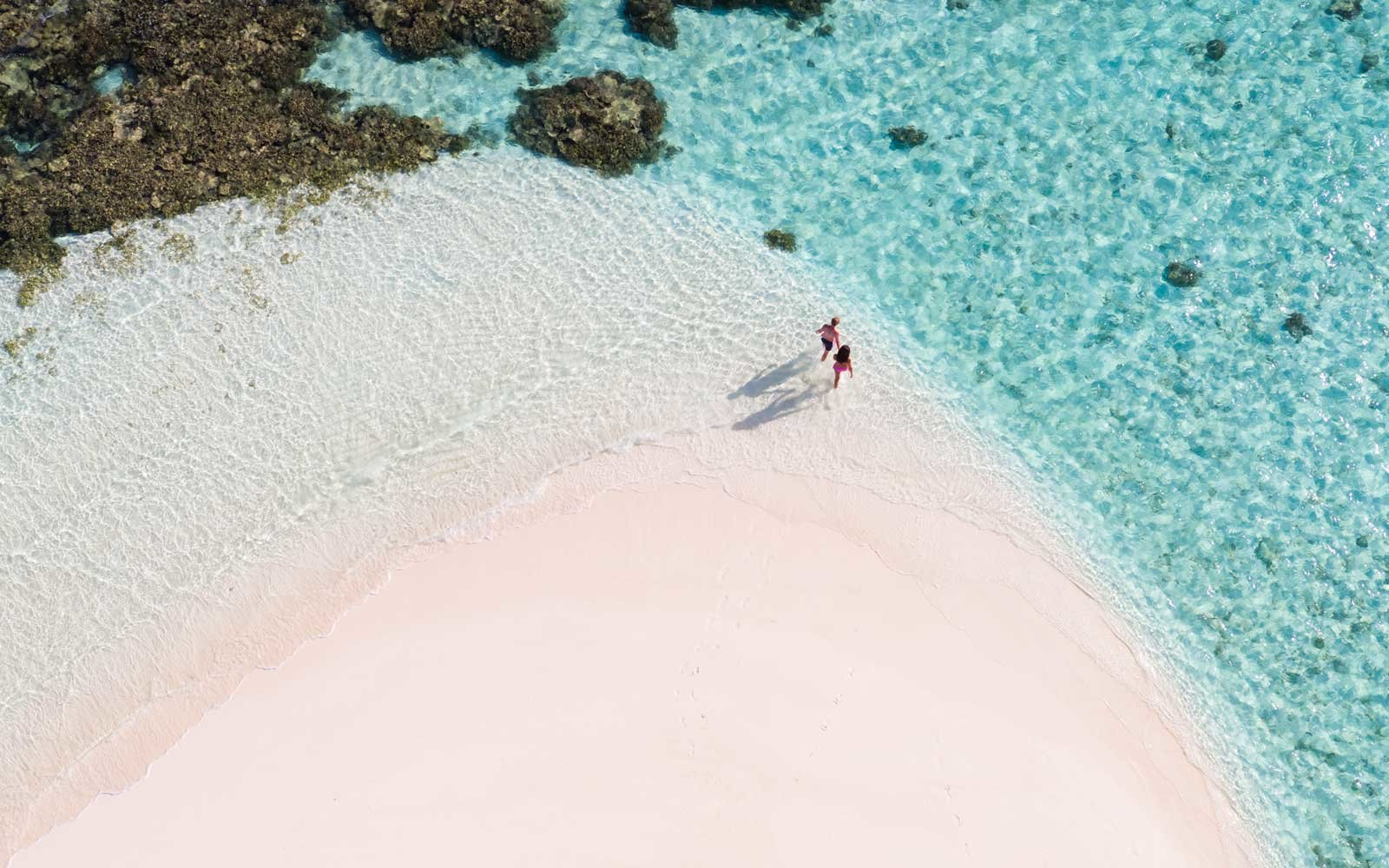 Overhead view of couple on a beach, Maldives, Ari Atoll