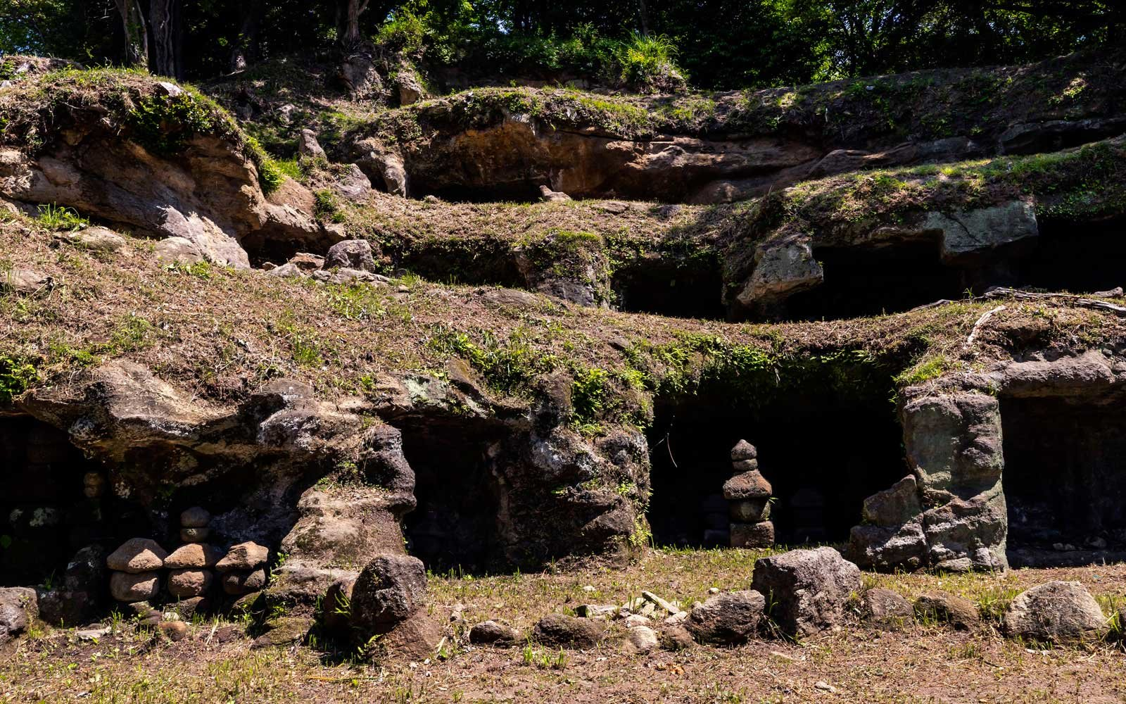 Mandarado Yagura a series of caves sites along an ancient footpath that is now a popular hiking trail that passes through three cuttings known as the Nagoe Kiridoshi.