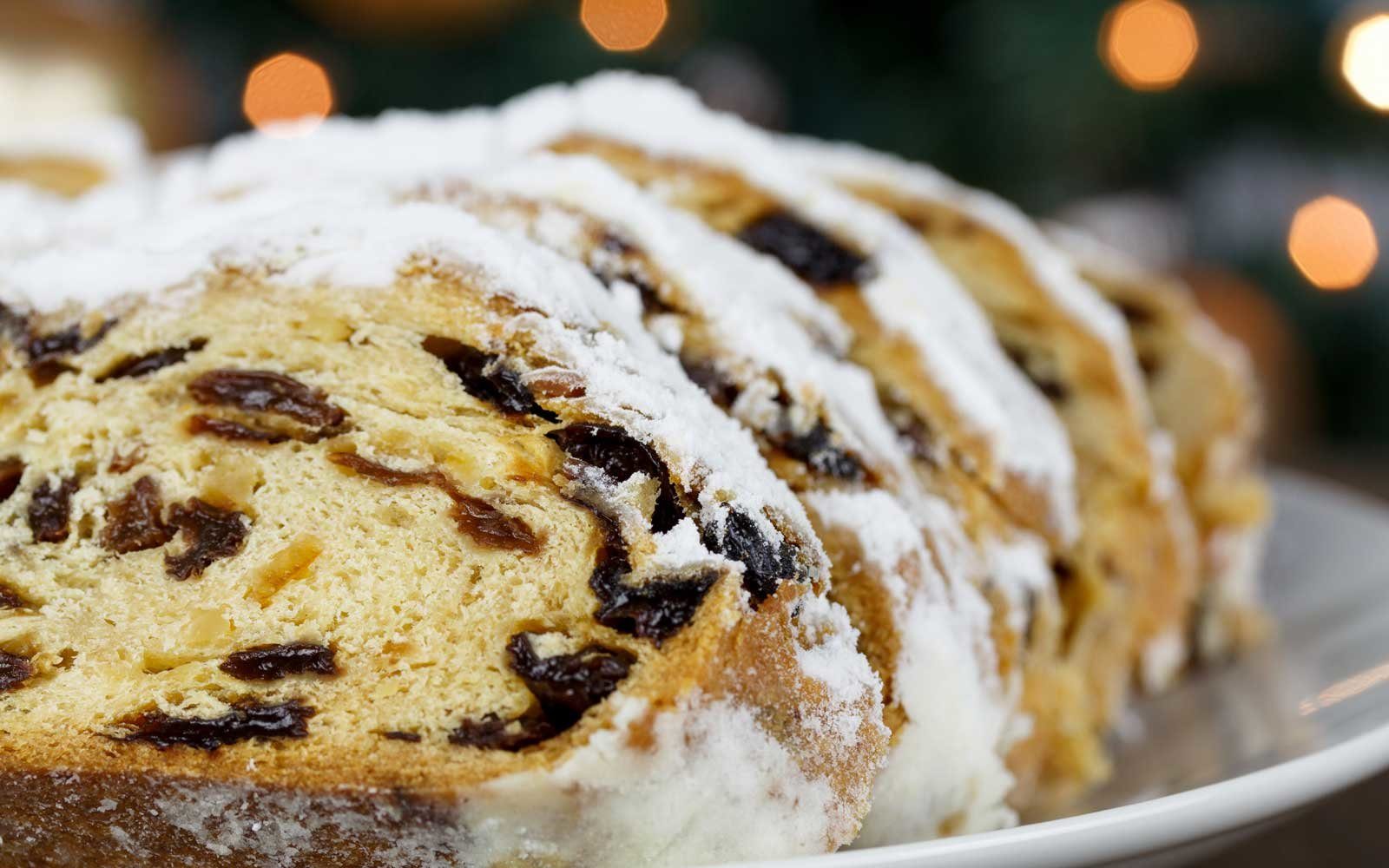Ingredients like raising, butter, sweet and bitter almonds, candied orange and lemon peel, and stollen spices and combined to create this German delicacy.