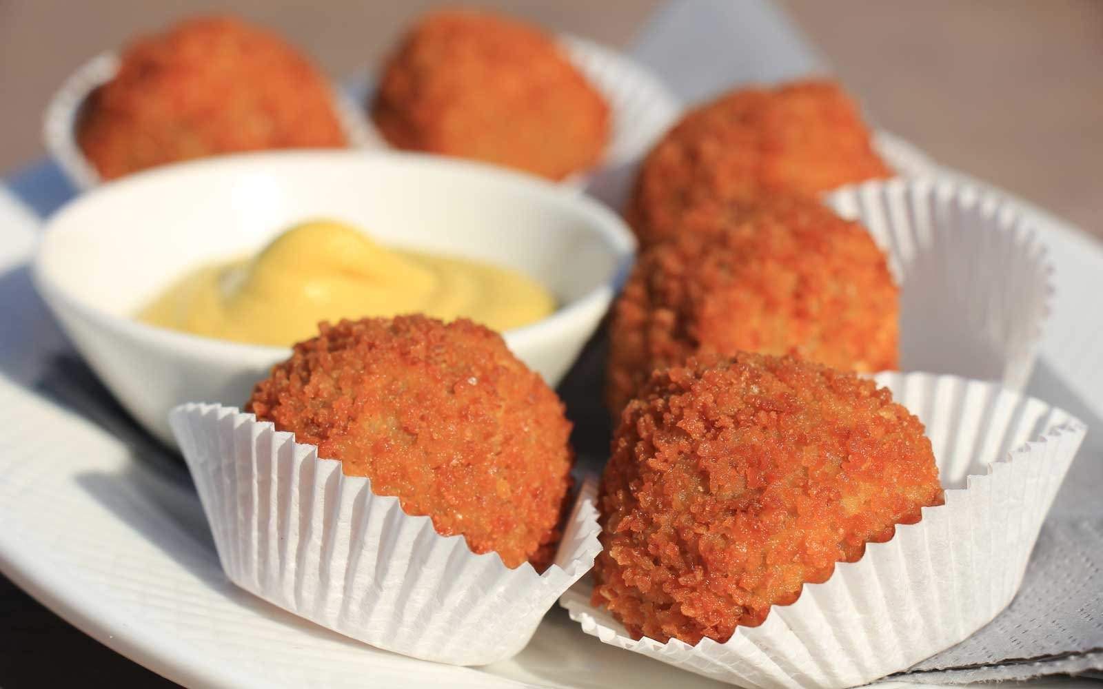 Bitterballen are a Dutch fried snack of stuffed and fried meatballs often served with mustard.