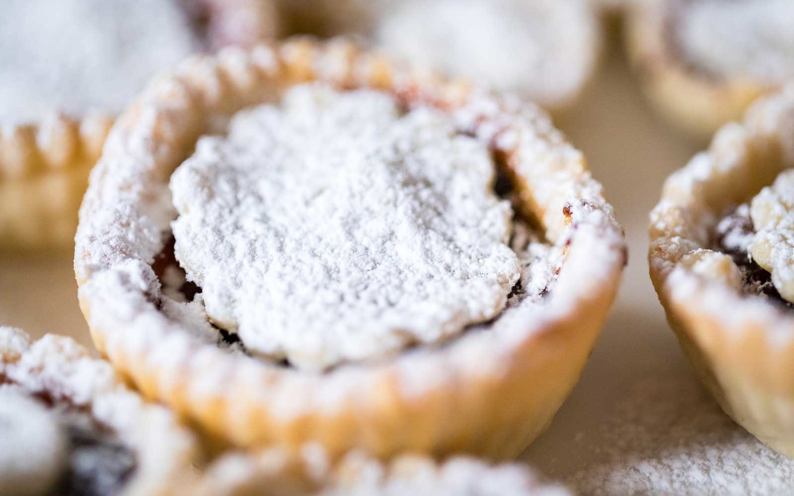 These miniature pies are typically made with fruit and chopped nuts and spices.