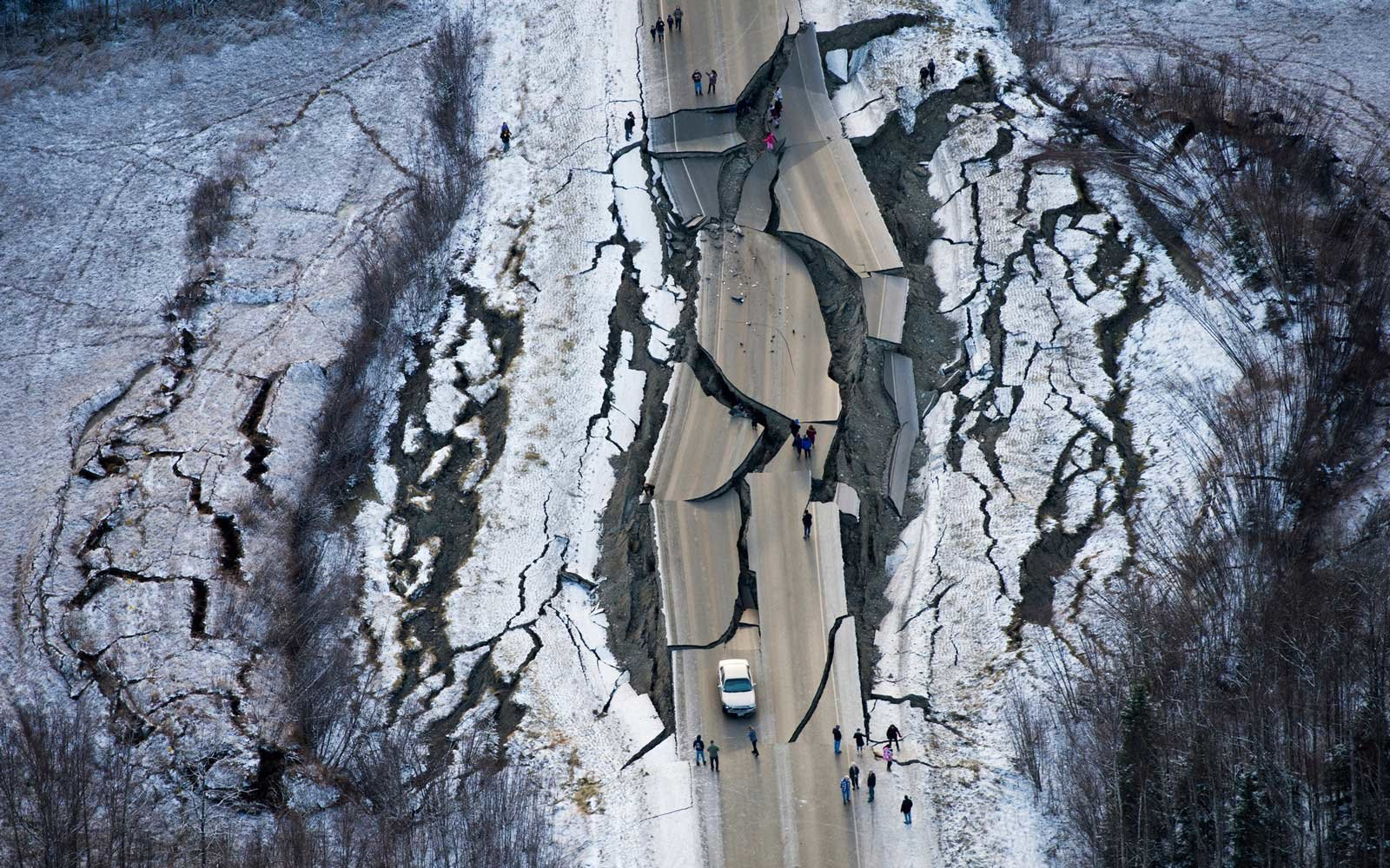 This aerial photo shows damage on Vine Road, south of Wasilla, Alaska, after earthquakes Friday, Nov. 30, 2018