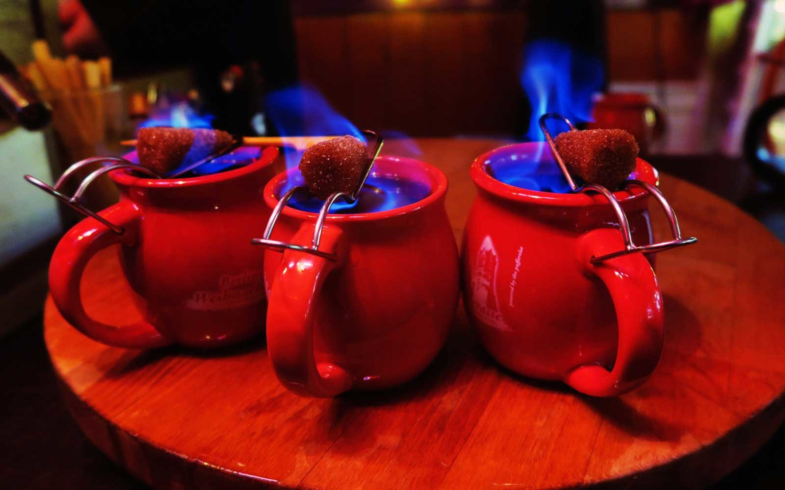 This flaming punch is made by soaking sugarloaf and dripping it into mulled wine.