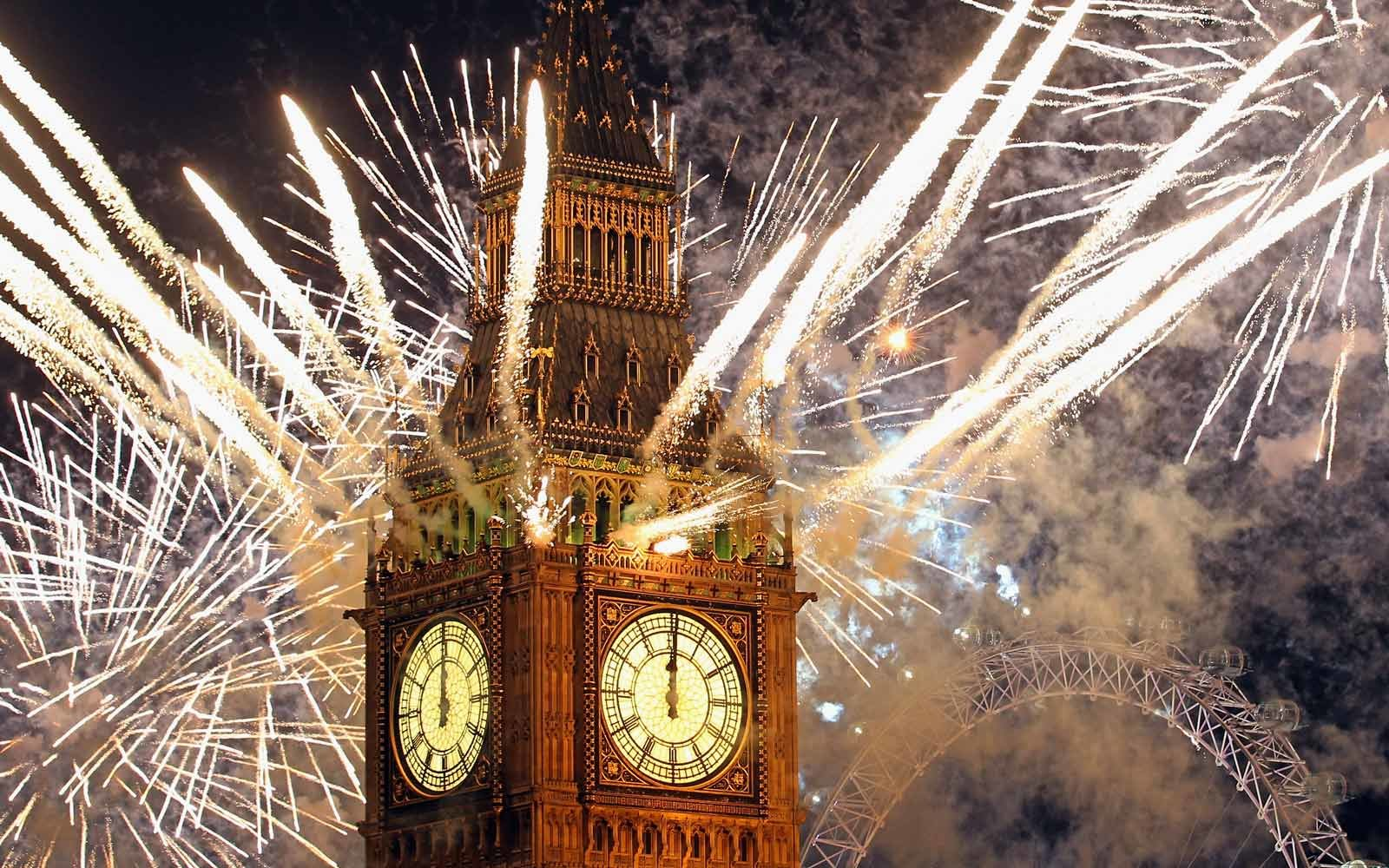 Fireworks light up the London skyline and Big Ben just after midnight on New Year's Eve in London, England