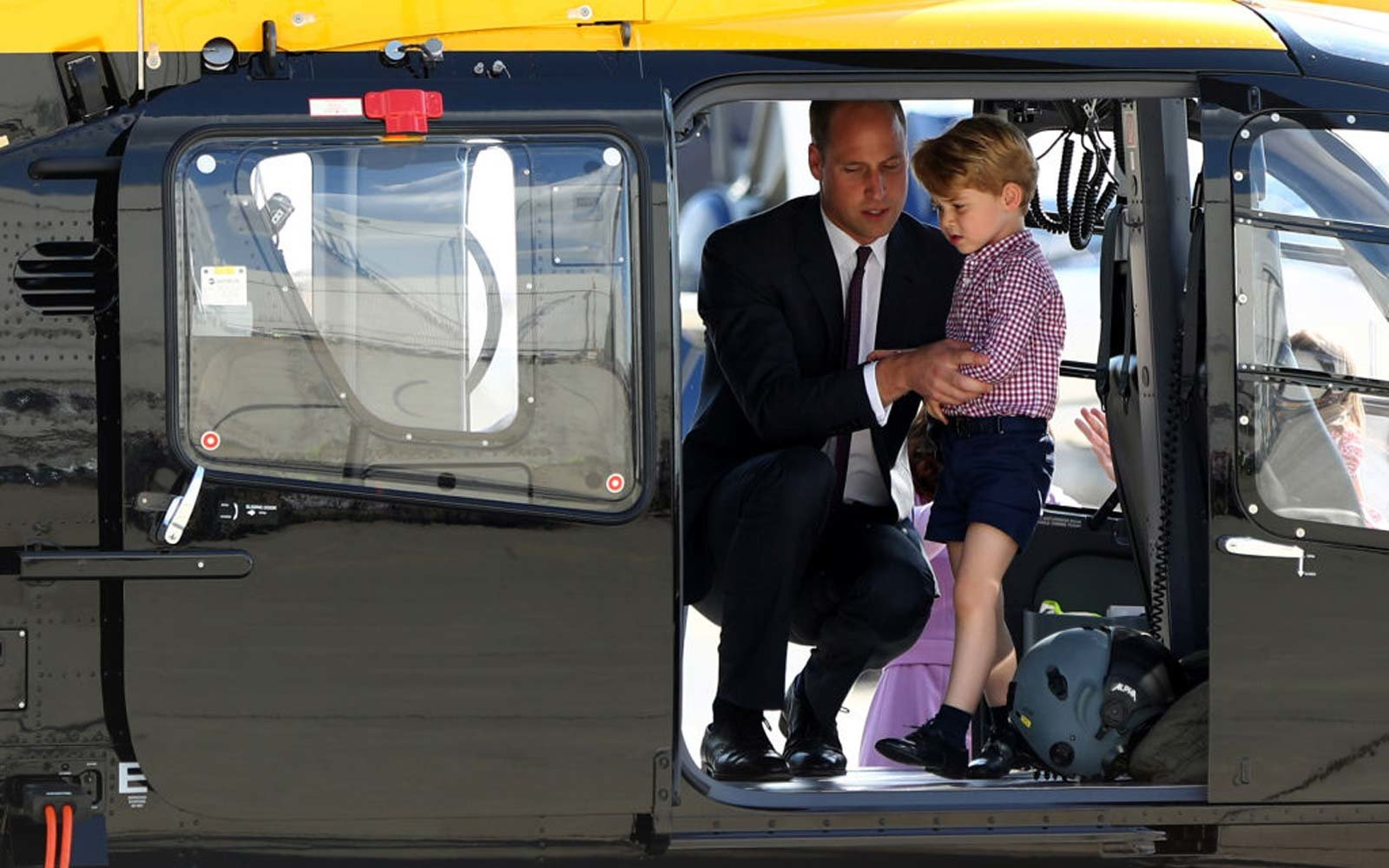 Great Britain's Prince William looks at the interior of a Airbus helicopter with his son George in Hamburg, Germany