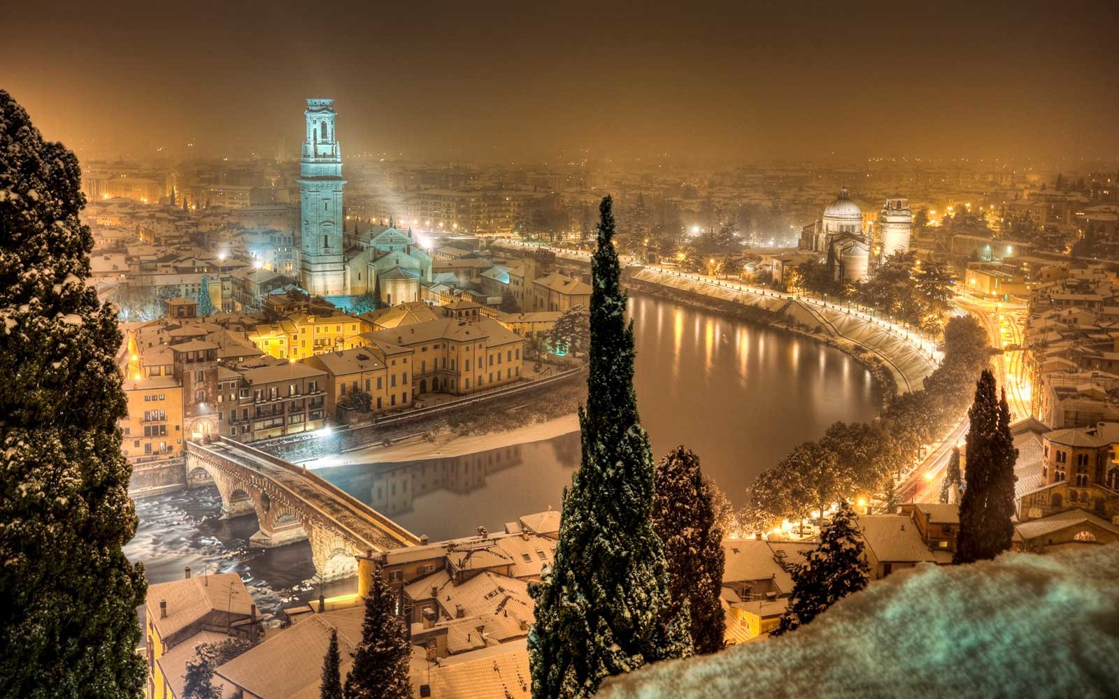 A panoramic view of Verona, Italy by night