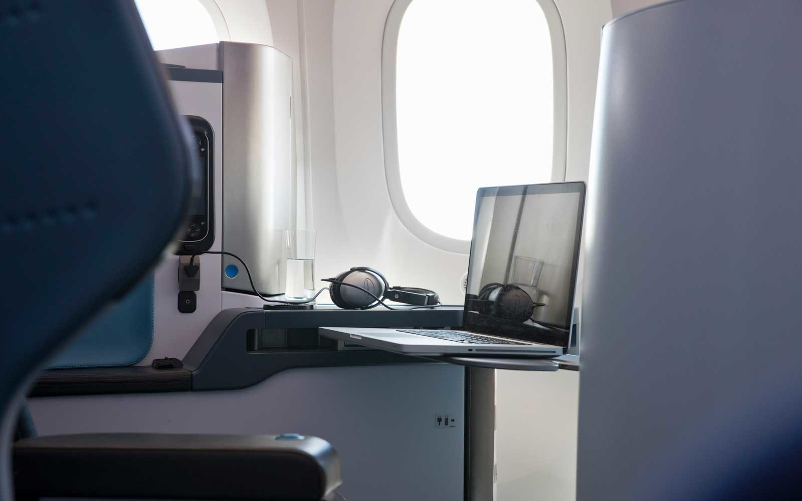 Laptop in business class on an airplane