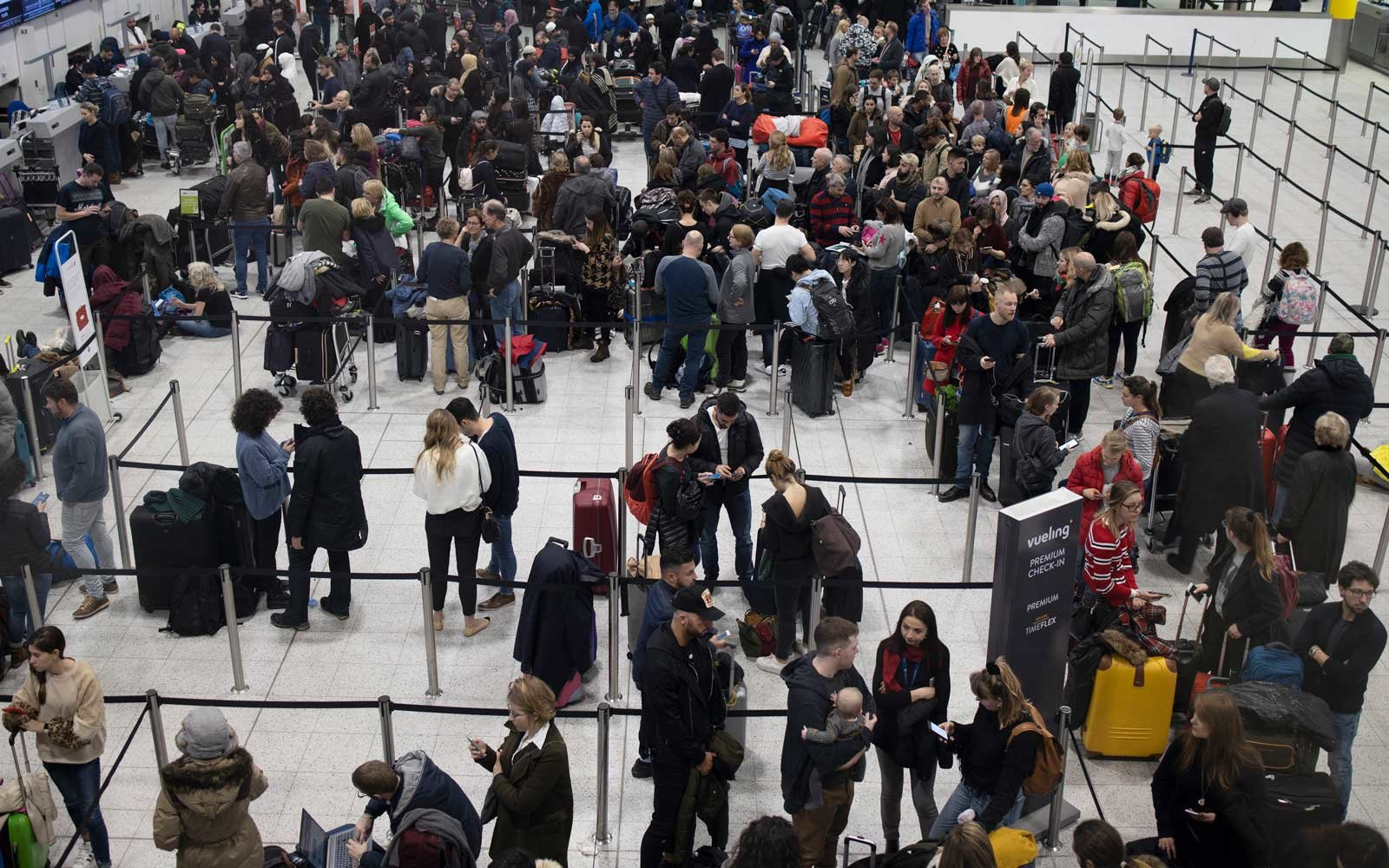 Passengers wait for announcements at Gatwick South Terminal on December 20, 2018 in London, England.
