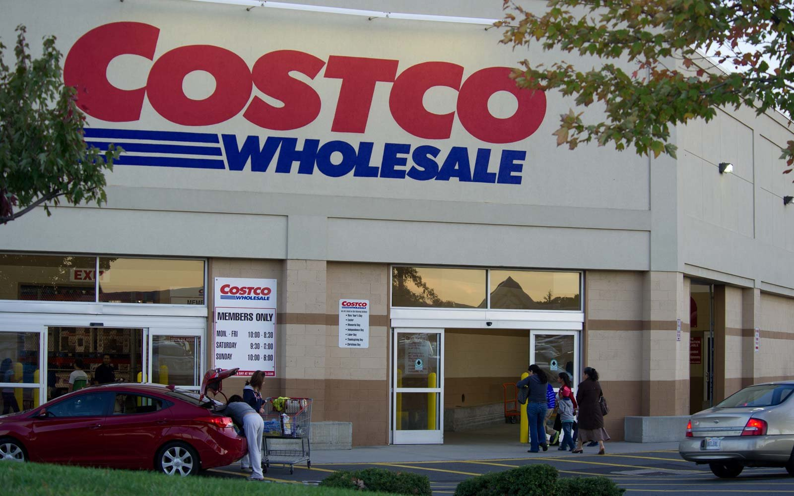 A shopper loads items into her car after shopping at Costco Wholesale Club in Manassas, Virginia