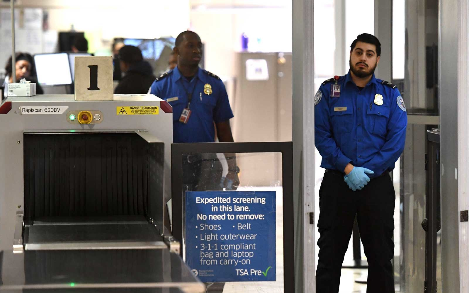 Transportation Security Administration officers (TSA) stand on duty at the departure area of the Los Angeles International Airport in Los Angeles, California, on 5 January, 2019
