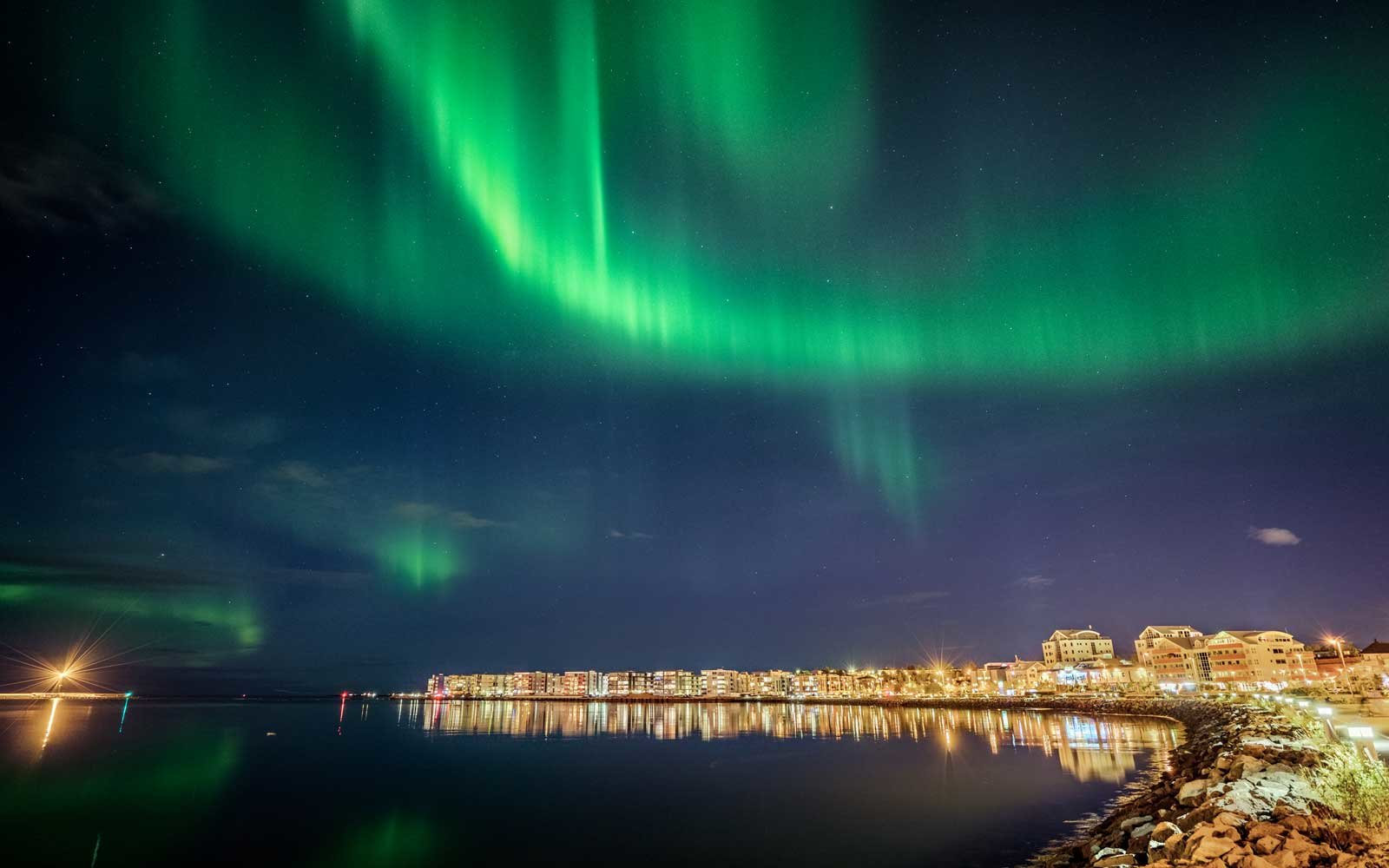 Take a package tour to see the Northern Lights.