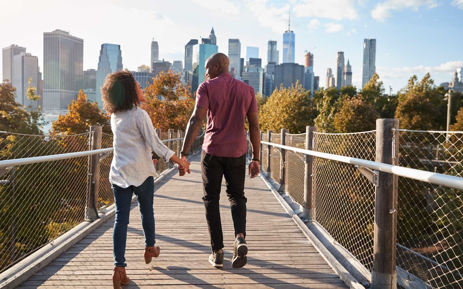 Couple in Brooklyn overlooking Manhattan