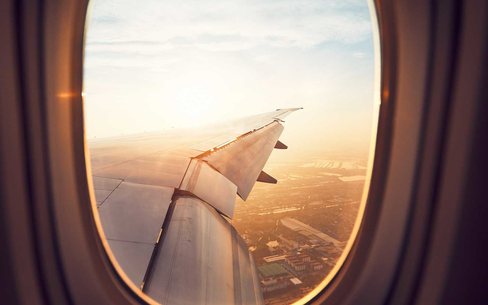 View from the window of the airplane at sunrise. Landing in Bangkok, Thailand.