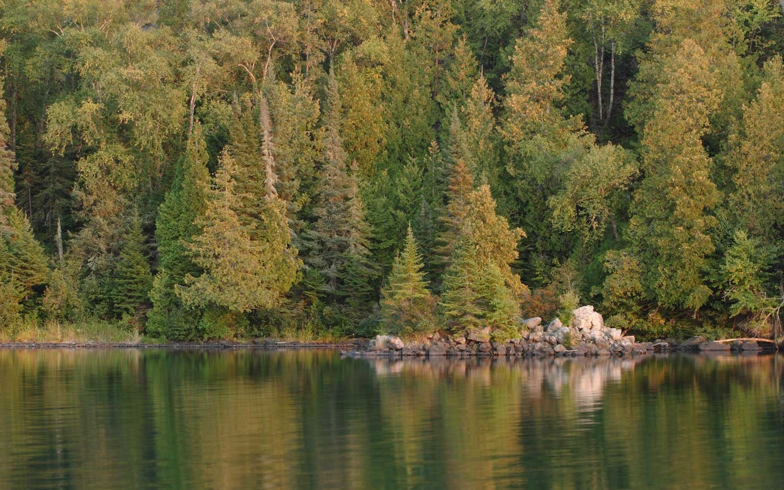 The Chippewa Harbor creates a scenic reflection at the Isle Royale National Park in Michigan.