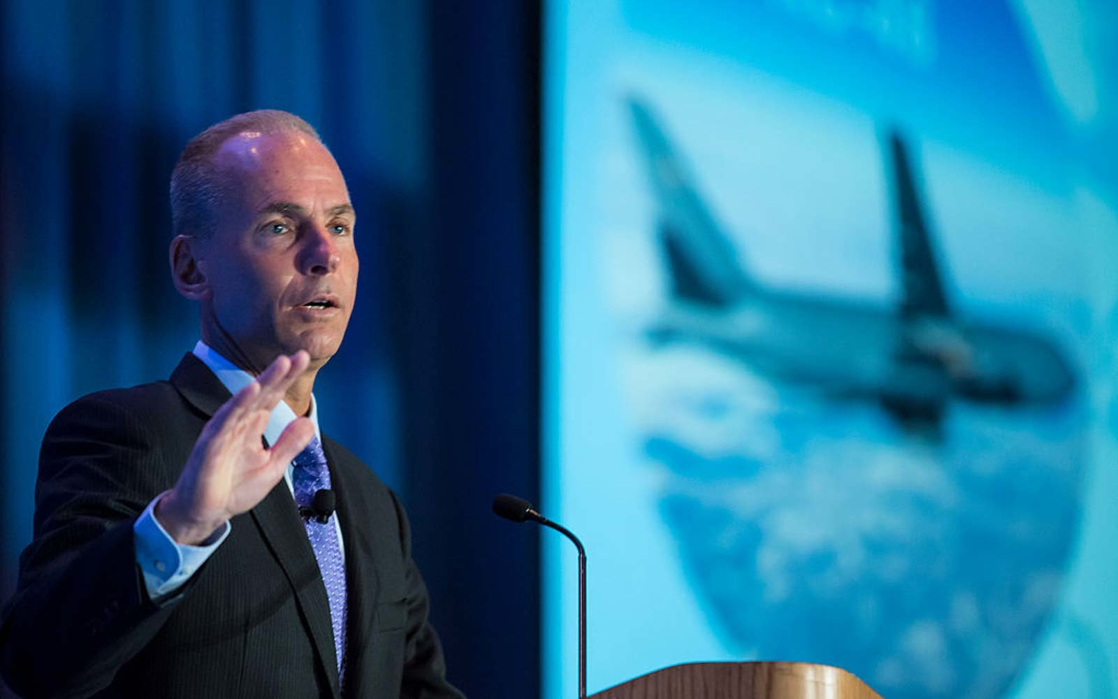 Boeing CEO Dennis Muilenburg gives a keynote speech during the SAE Aerotech Congress