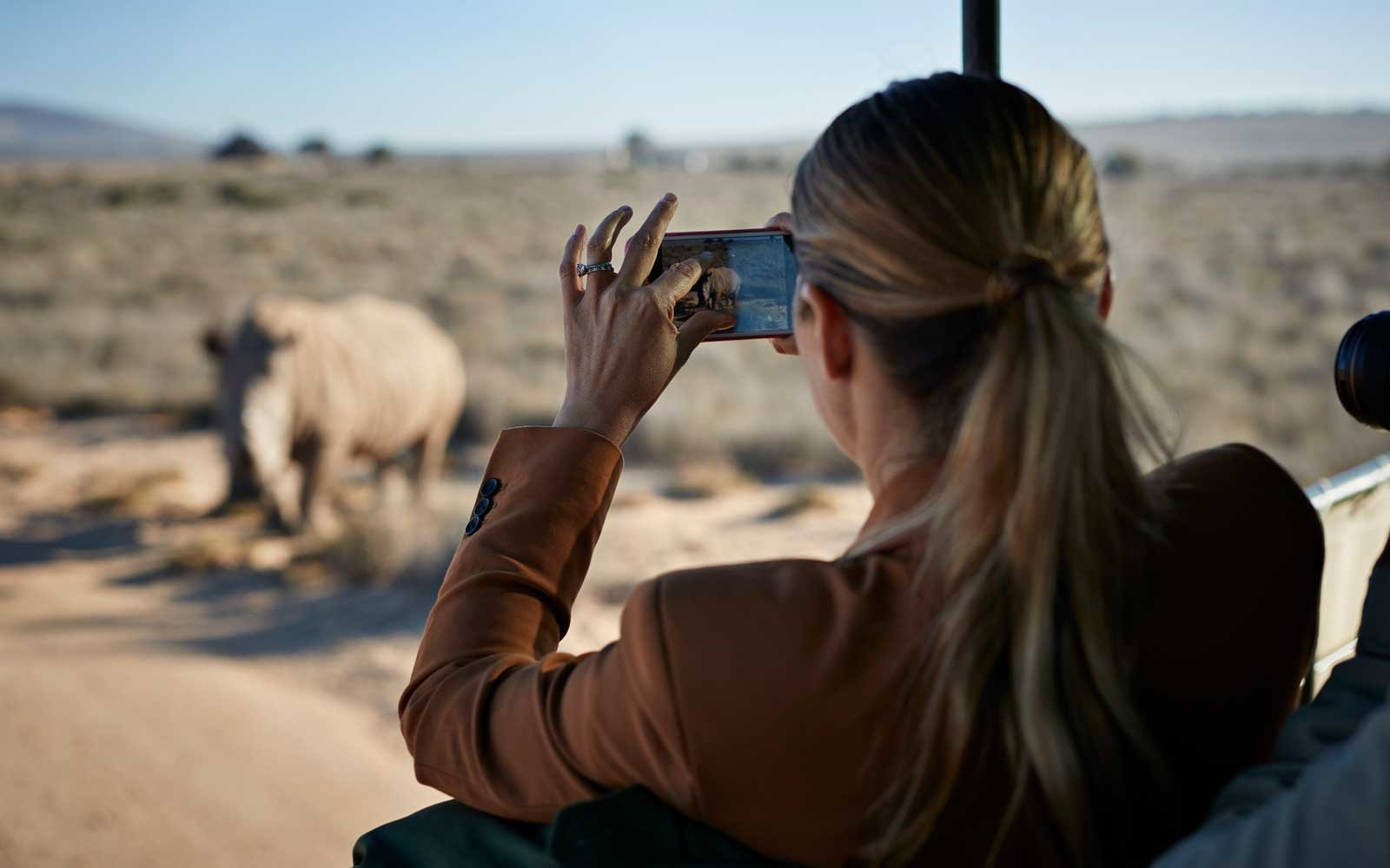 Woman taking photos on safari