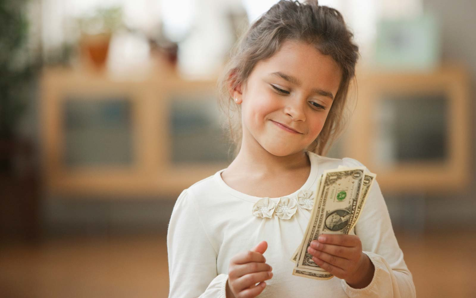 When to give your kids an allowance, according to a financial planner