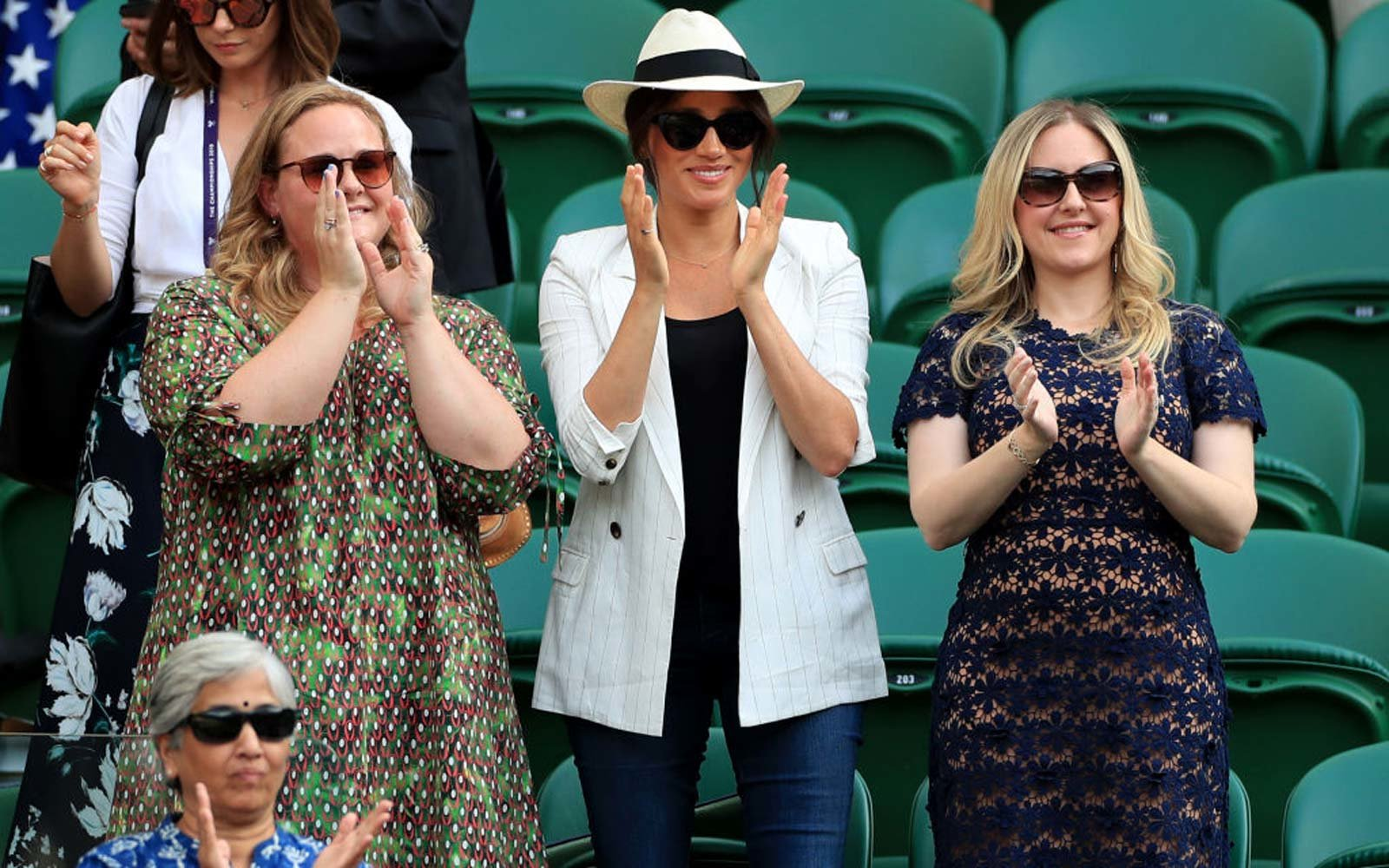 Duchess of Sussex applauds after watching Serena Williams on court one on day four of the Wimbledon Championships at the All England Lawn Tennis and Croquet Club, Wimbledon