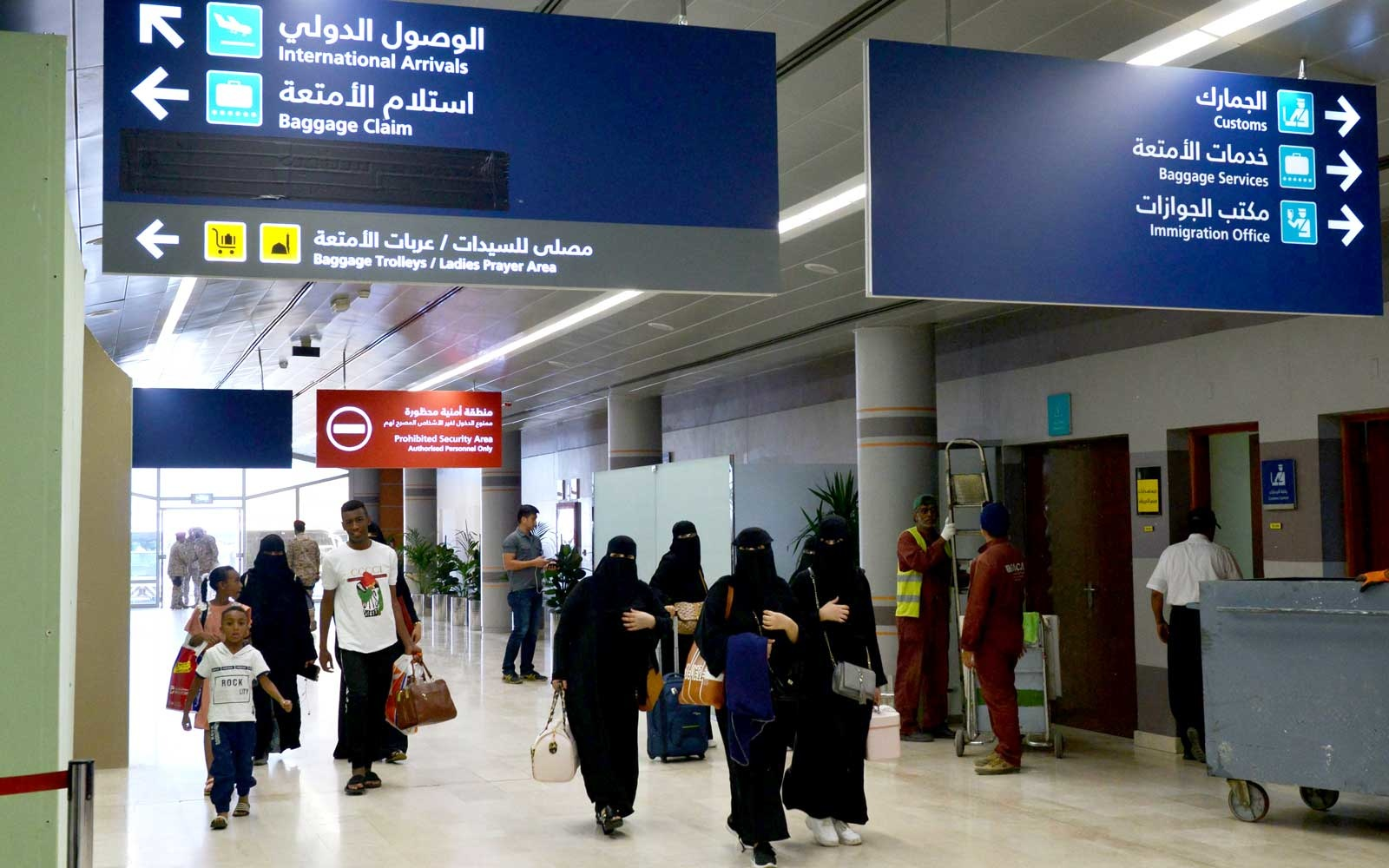 June 13, 2019 shows Saudi women arriving at Abha airport in the popular mountain resort of the same name in the southwest of Saudi Arabia