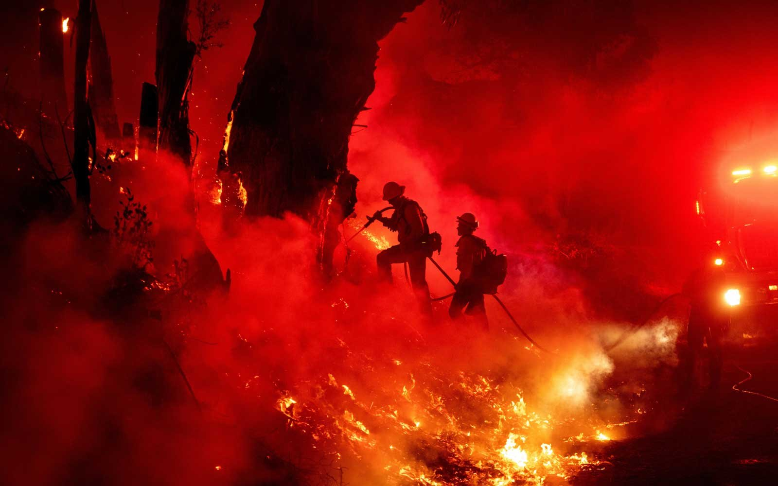 Firefighters work to control flames from a backfire during the Maria fire in Santa Paula, California on November 1, 2019.