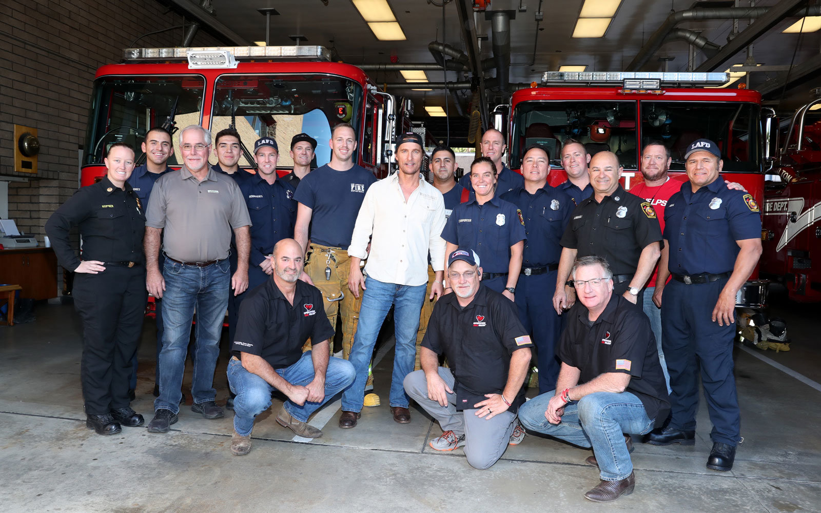 Matthew McConaughey with firefighters