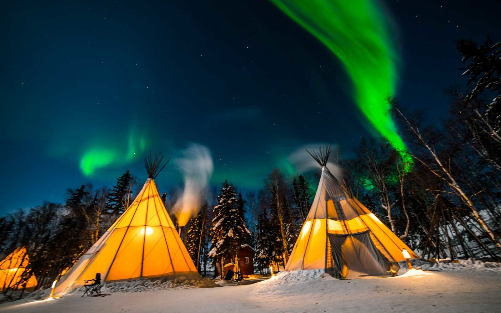 This cozy Canadian tepee village is one of the best places to see the Northern Lights