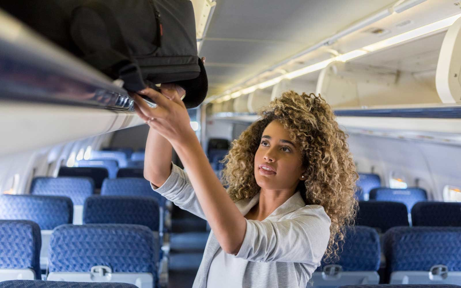 Why you should never store your carry-on behind you on a plane