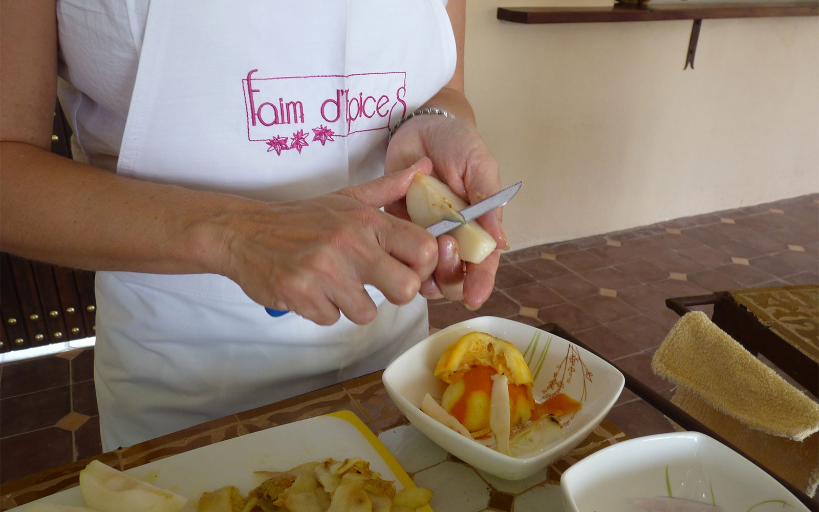 student cooking at Faim d'Epices culinary school, Morocco