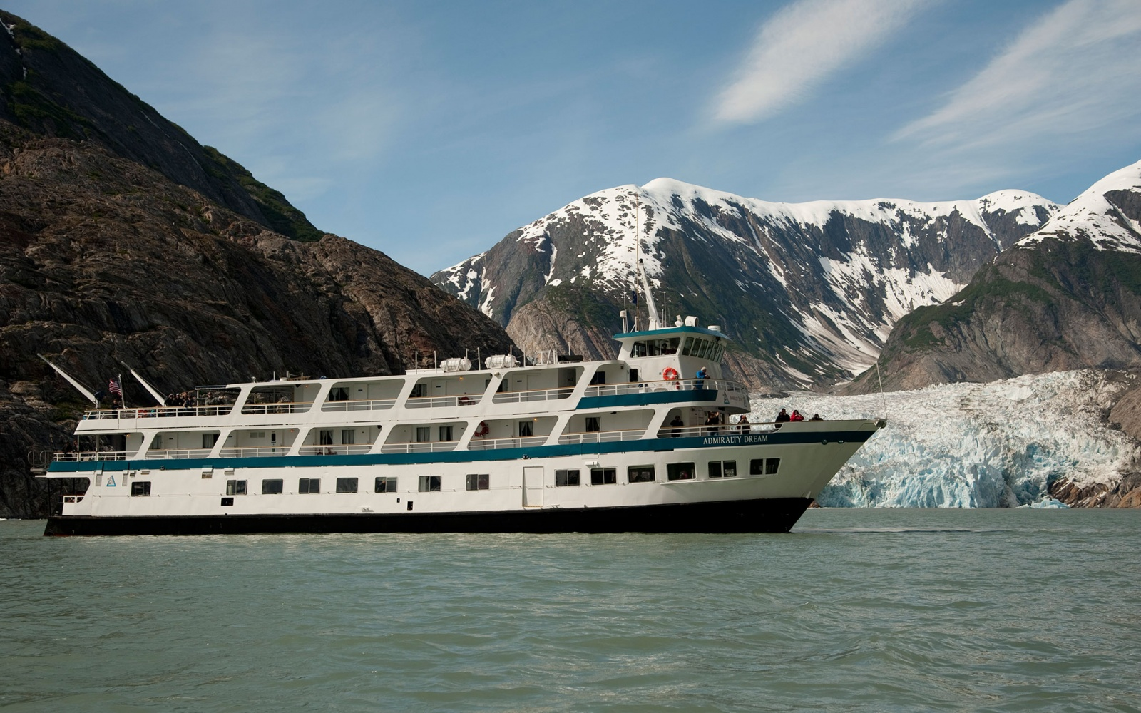 Alaskan Dream Cruises cruising alongside an Alaskan glacier