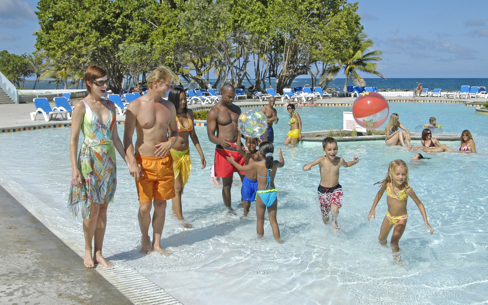 Family In Pool At Coconut Bay Beach Resort U0026 Spa, St. Lucia