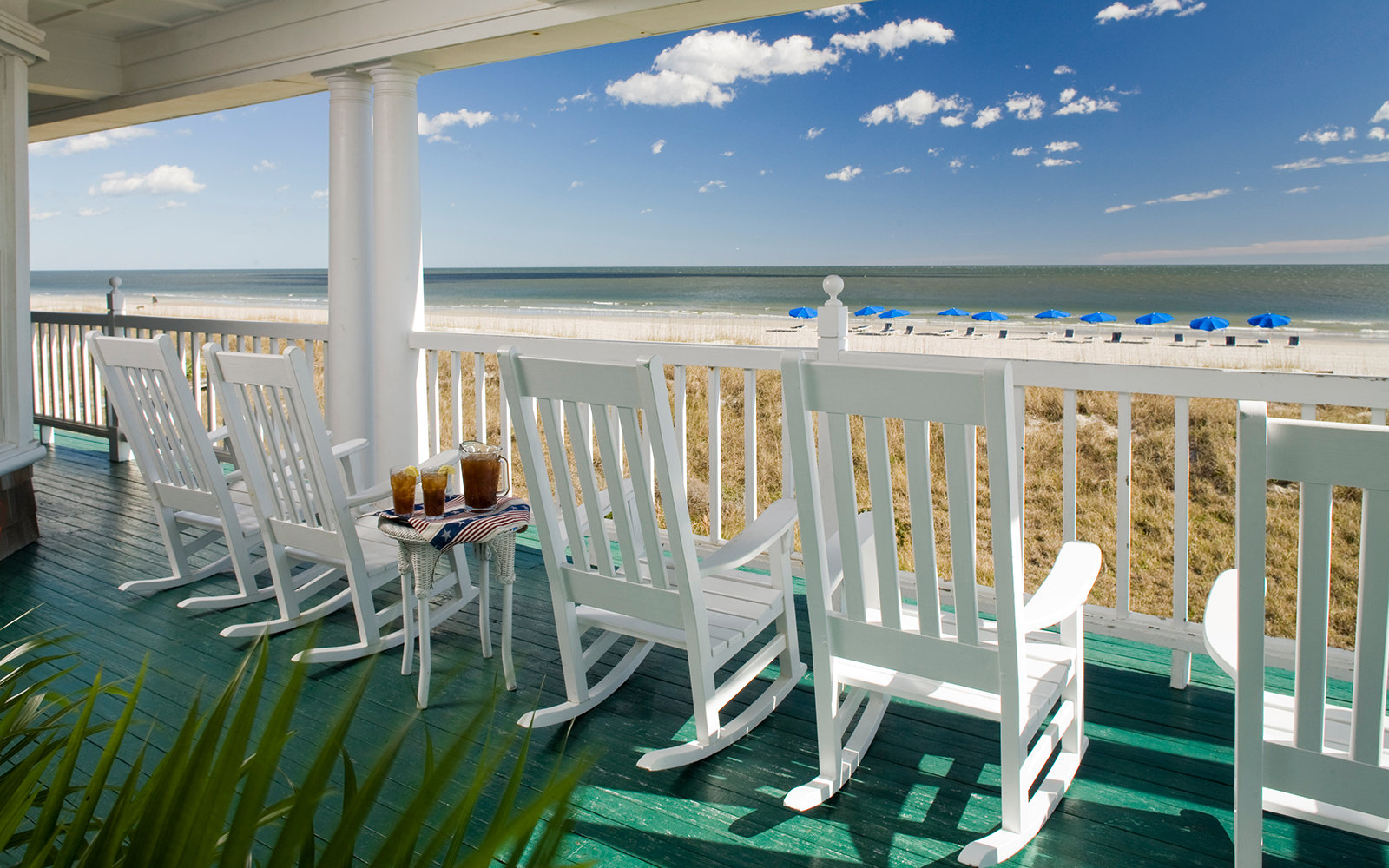 beach chairs overlooking the beach at Elizabeth Pointe Lodge in Amelia Island, FL